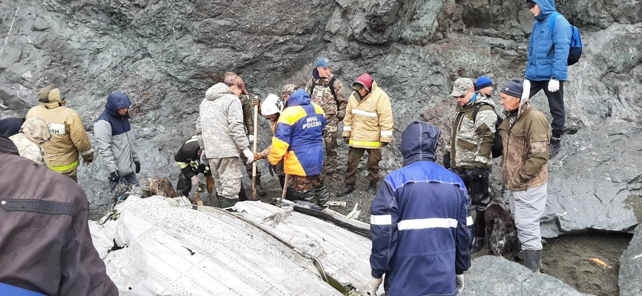 Specialists of the Russian Emergencies Ministry are seen at the crash site of a Russian An-26 passenger plane near the village of Palana in the north of the Kamchatka peninsula, Russia July 7, 2021. Russia's Emergencies Ministry/Handout via REUTERS