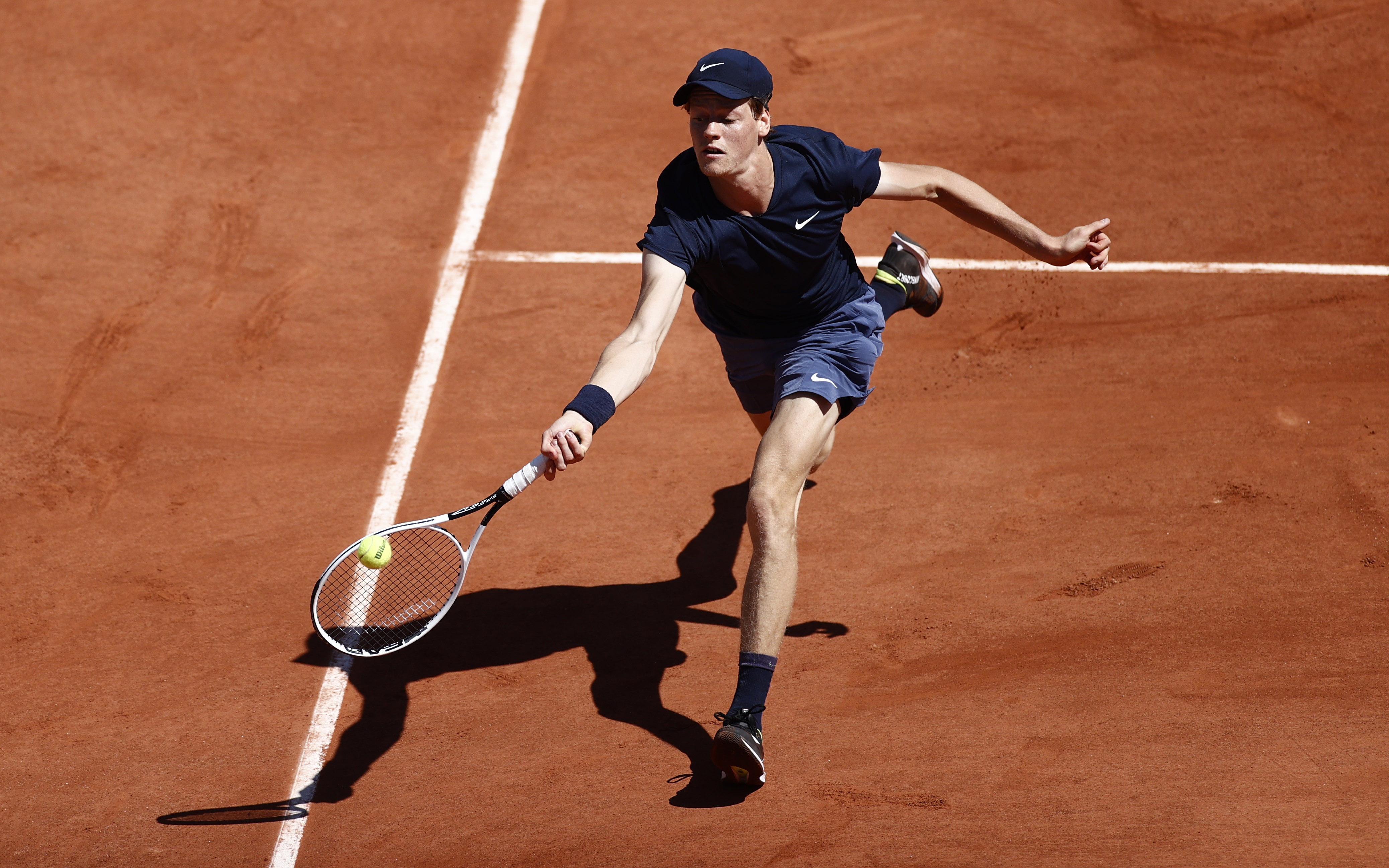 Tennis - French Open - Roland Garros, Paris, France - May 31, 2021 Italy's Jannik Sinner in action during his first round match against France's Pierre-Hugues Herbert REUTERS/Christian Hartmann
