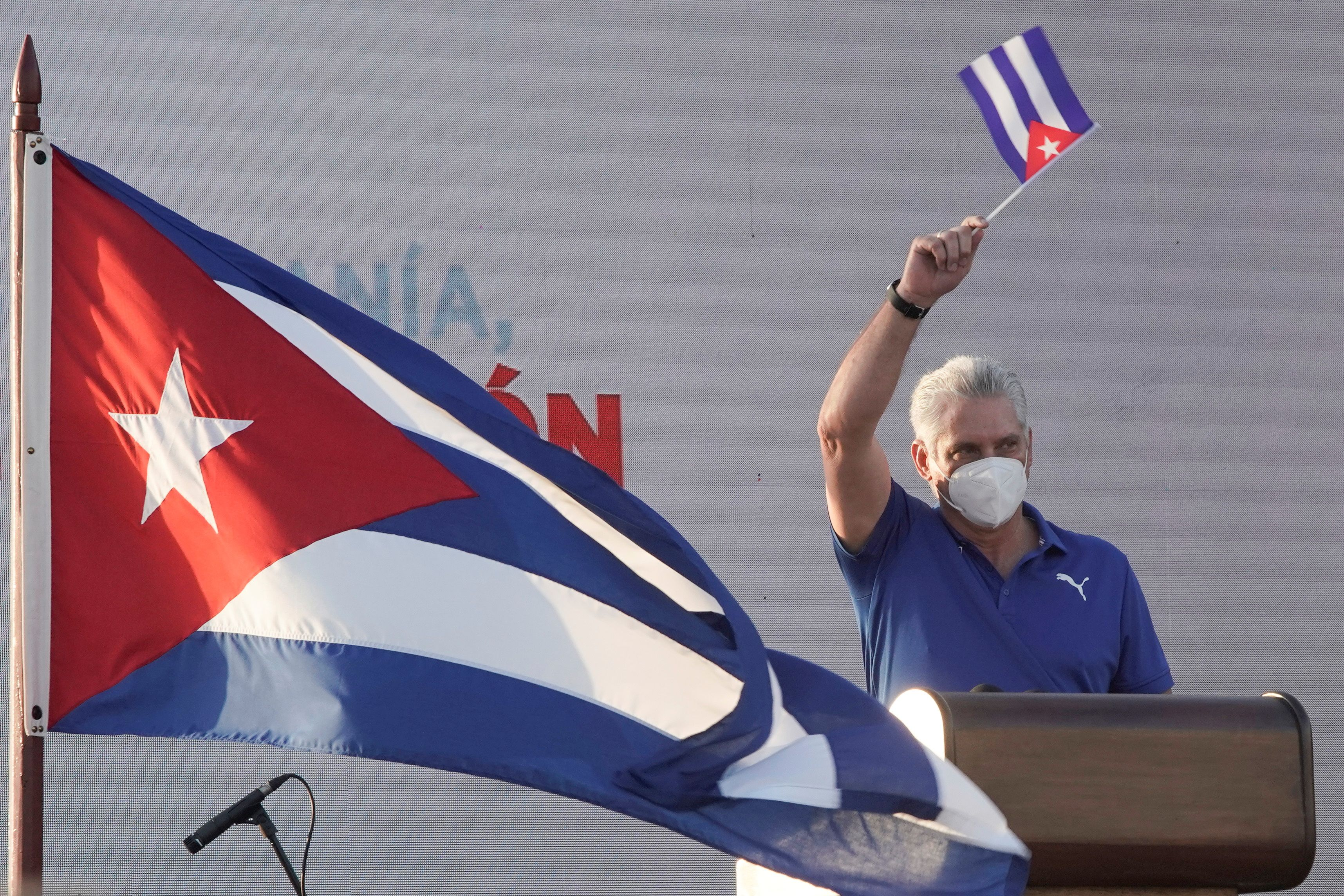 Cuba's President and First Secretary of the Communist Party Miguel Diaz-Canel waves a Cuban national flag as he delivers a speech during a rally in Havana, Cuba, July 17, 2021. REUTERS/Alexandre Meneghini