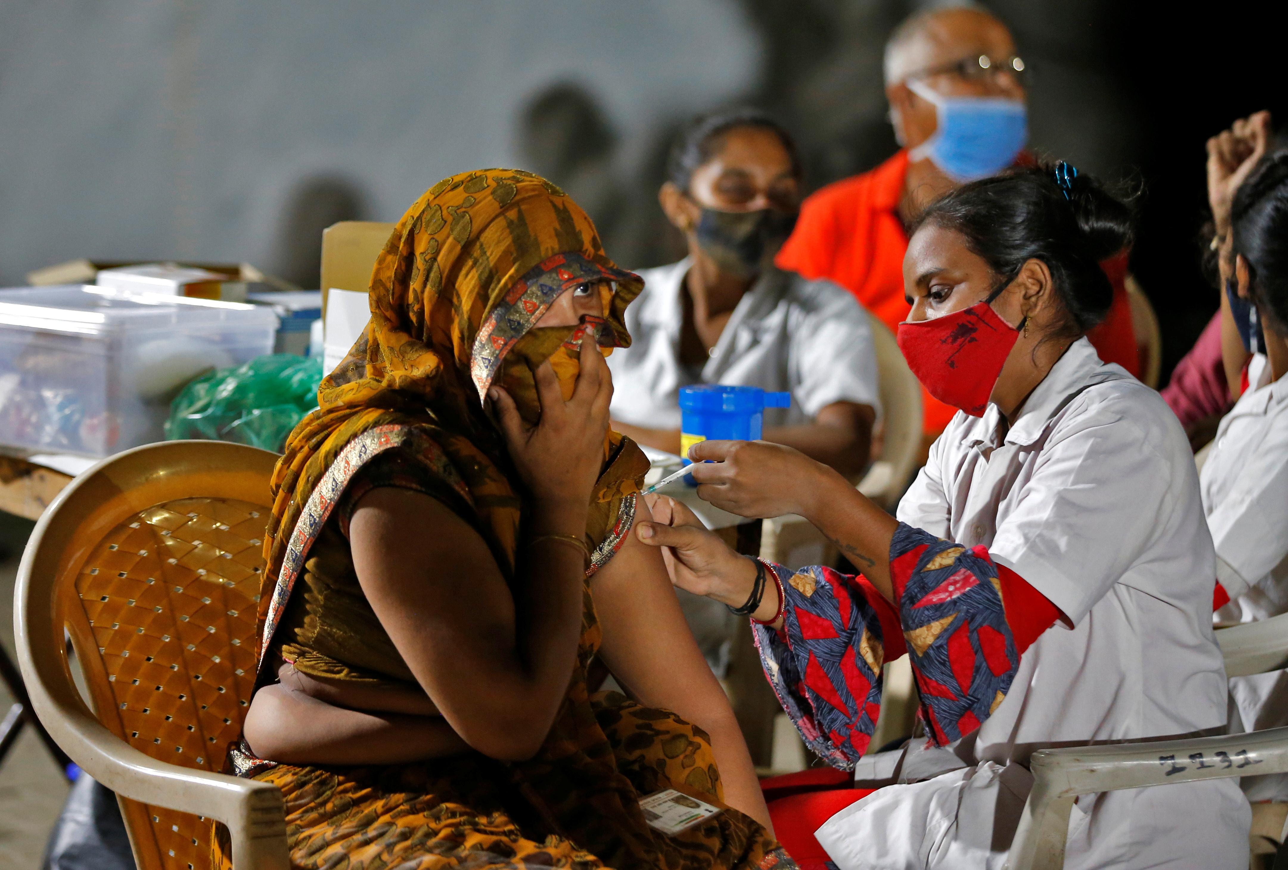 Modi hails India's 10 mln COVID vaccine doses in a single day | Reuters