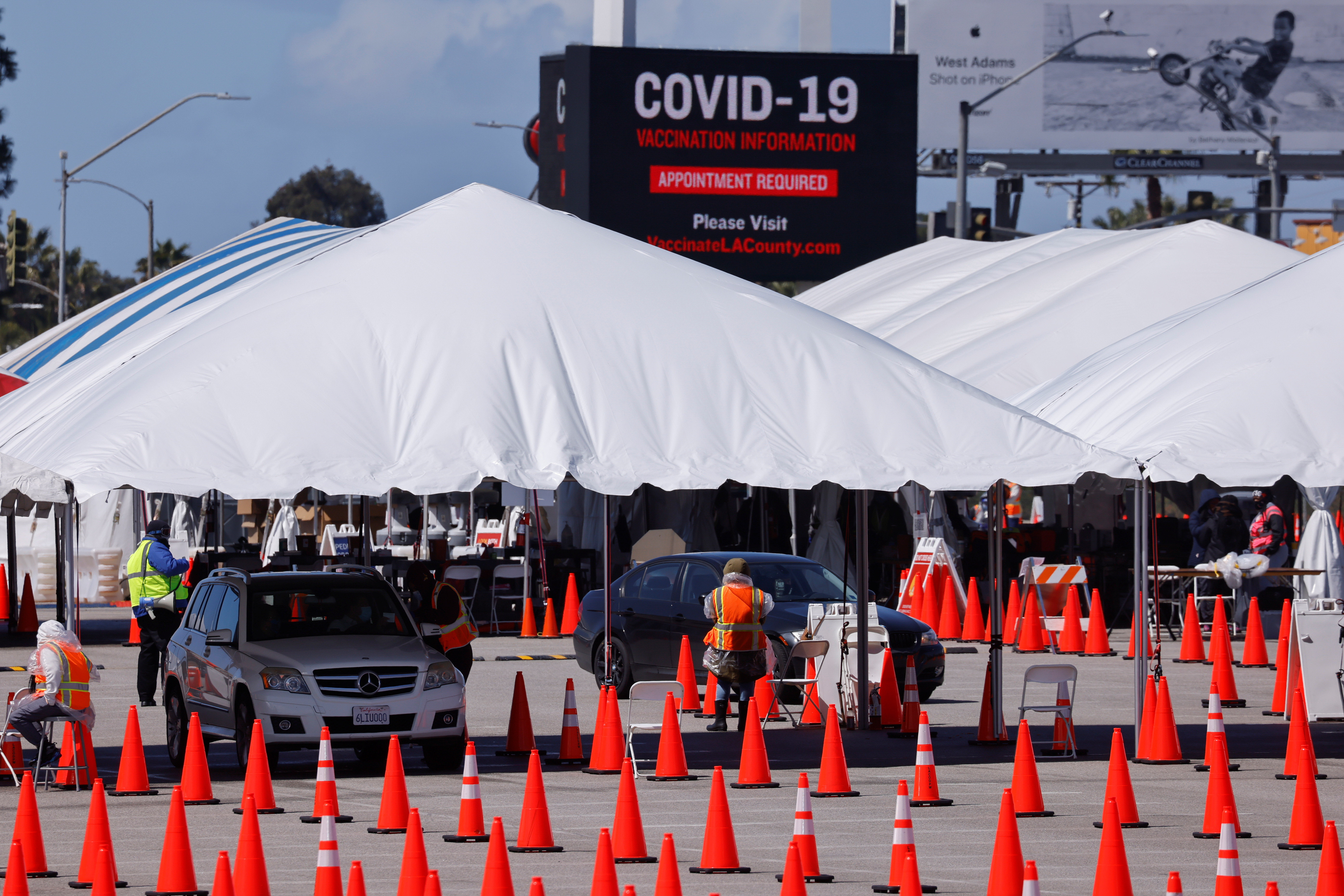 A large vaccination site is shown as people with preexisting health conditions are granted access to a vaccination during the outbreak of the coronavirus disease (COVID-19) in Inglewood, California, U.S., March 15, 2021.  REUTERS/Mike Blake