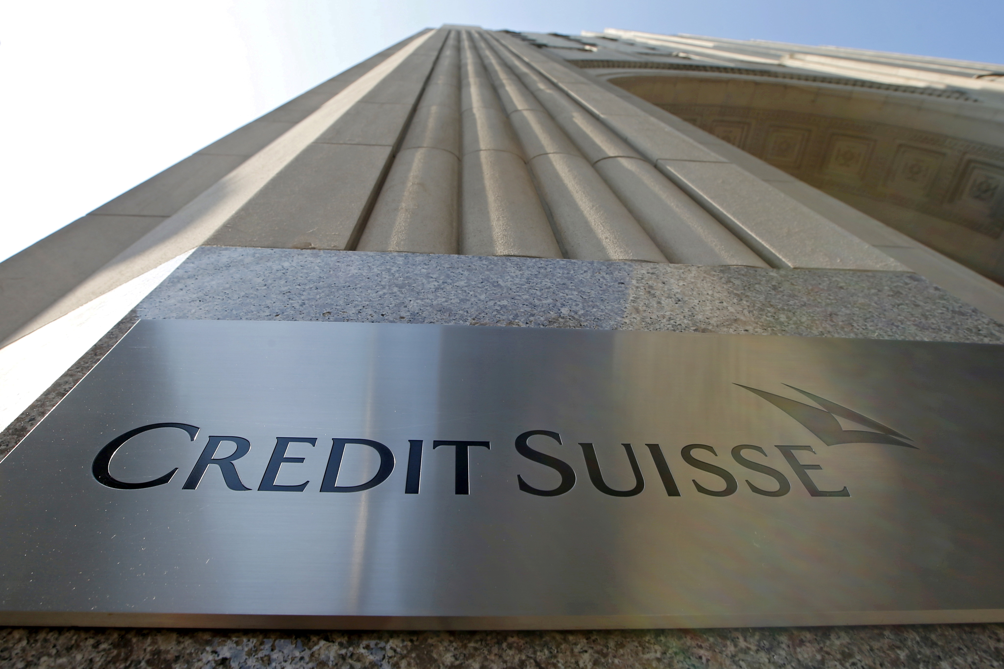 A Credit Suisse sign is seen on the exterior of their Americas headquarters in the Manhattan borough of New York City, September 1, 2015.  REUTERS/Mike Segar/File Photo