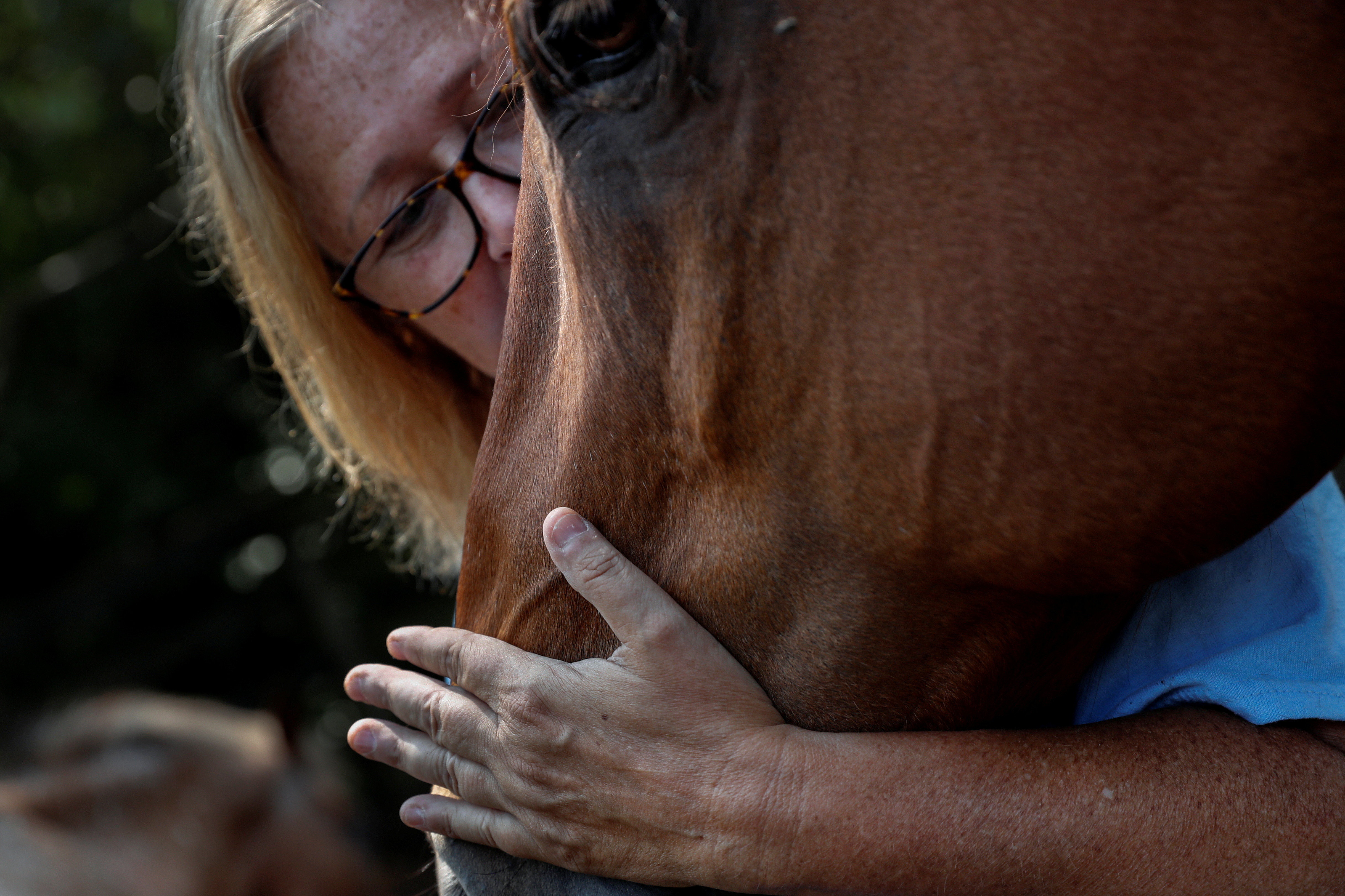 Kayla Bergeron pets an equine therapy horse at Special Equestrians of Georgia in Milton, Georgia, July 3, 2021.    REUTERS/Shannon Stapleton
