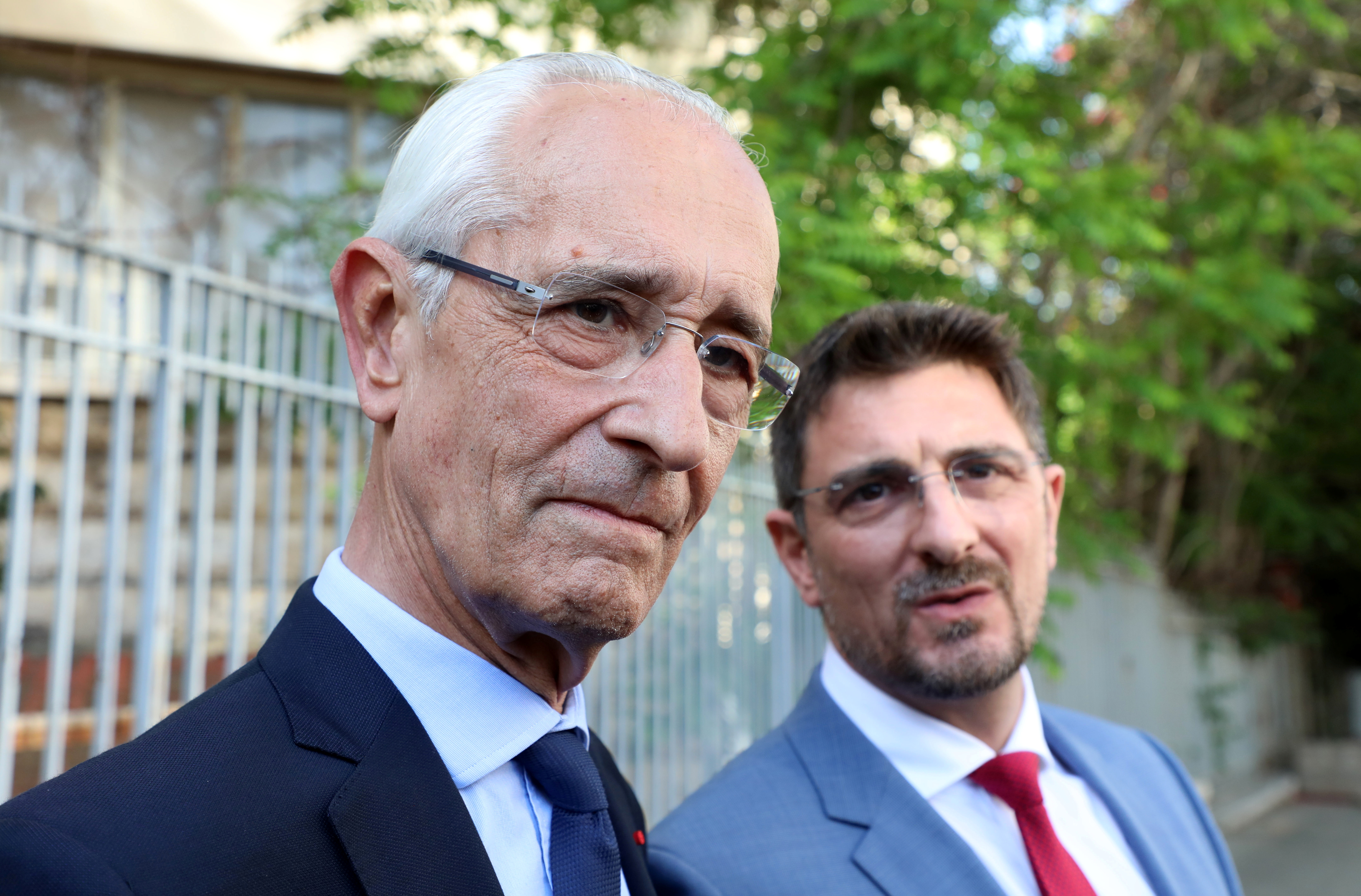 Jean Yves Le Borgne and Jean Tamalet, lawyers of fugitive former car executive Carlos Ghosn, speak to journalists outside the Justice Palace, in Beirut, Lebanon May 31, 2021. REUTERS/Mohamed Azakir
