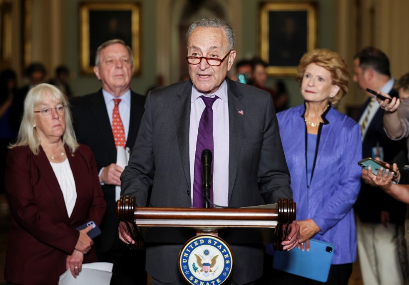 U.S. Senate Majority Leader Chuck Schumer (D-NY) is flanked by Senators'  Patty Murray (D-WA), Dick Durbin (D-IL) and Debbie Stabenow (D-MI) as he talks to reporters following the Senate Democrats weekly policy lunch at the U.S. Capitol in Washington, U.S., June 15, 2021. REUTERS/Evelyn Hockstein