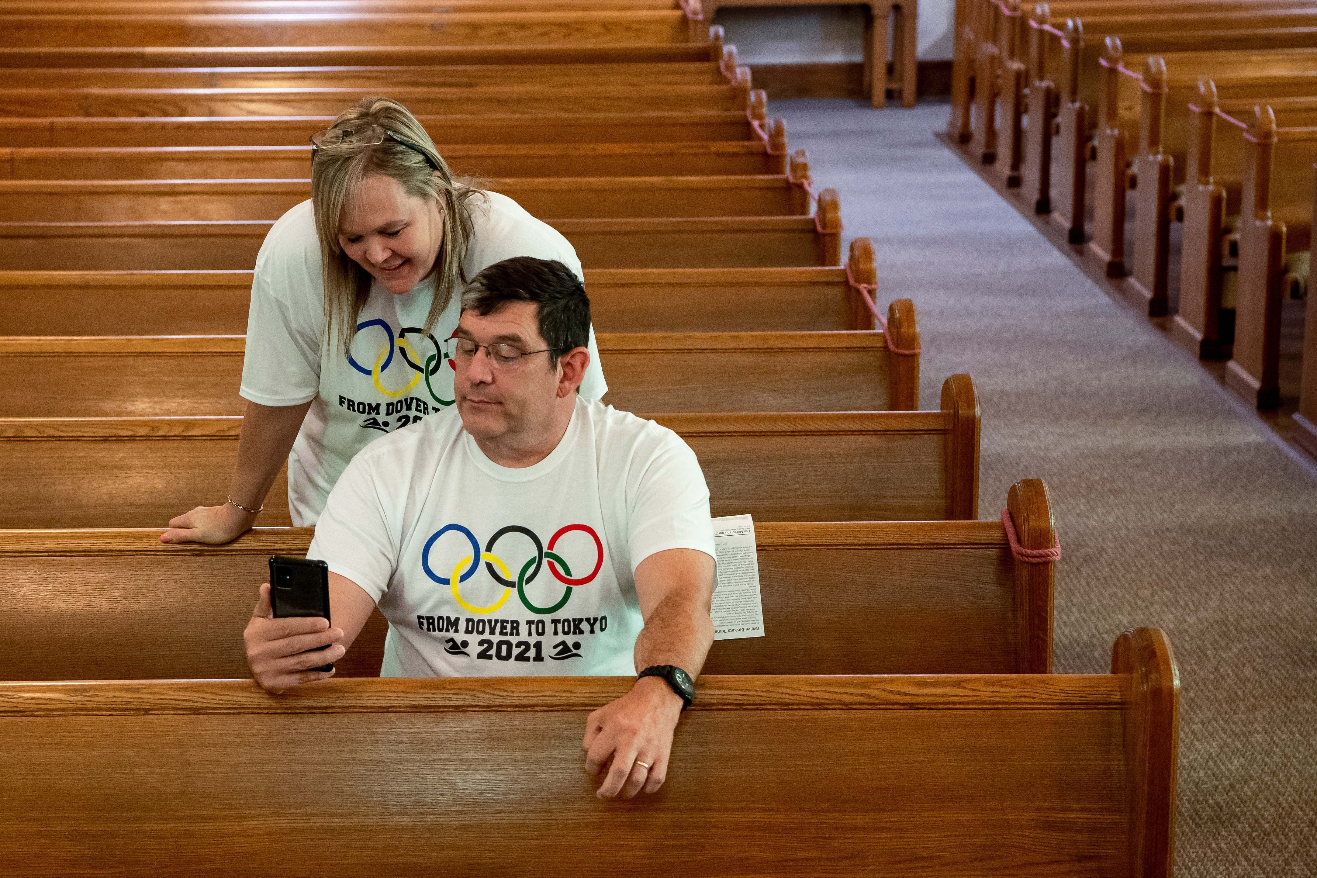 Ryan Armstrong and Edie Armstrong video chat with their son U.S. Olympic swimmer Hunter Armstrong, after church services at Dover First Moravian Church, before Hunter goes to bed and prepares to compete in the men's 100m backstroke semi-final the following day at the 2021 Olympic Games, in Dover, Ohio, U.S., July 25, 2021. Picture taken July 25, 2021. REUTERS/Gaelen Morse