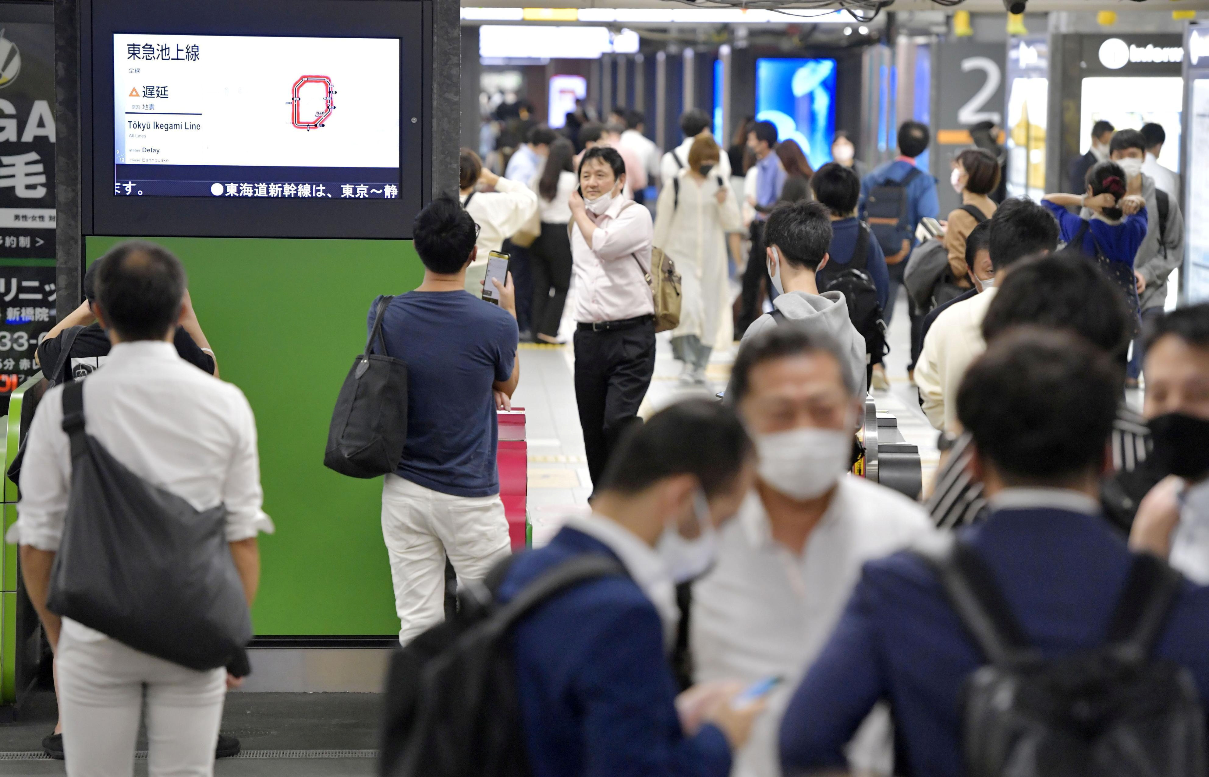The entrance of JR Shimbashi station is crowded with passengers as the train services are suspended following an earthquake in Tokyo, Japan in this photo taken by Kyodo October 7, 2021. Mandatory credit Kyodo/via REUTERS