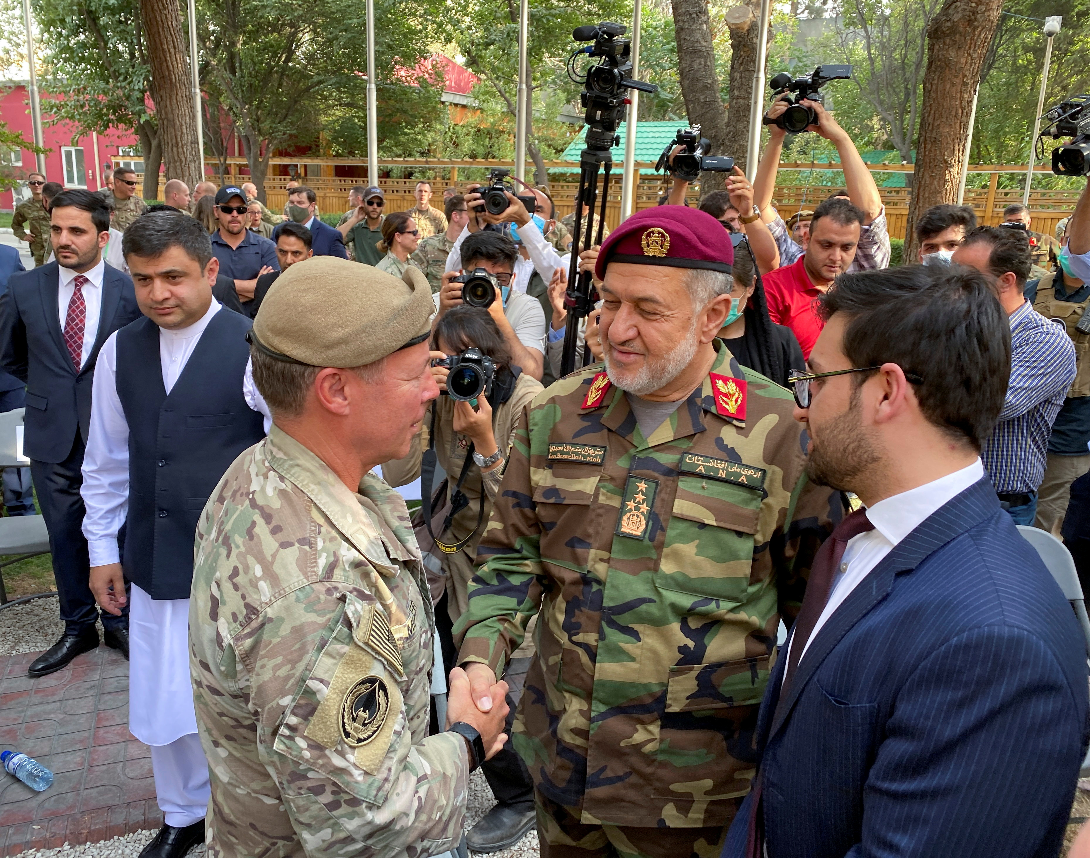 U.S. General Austin Miller, (L) shakes hand with Afghan Defense Minister Bismillah Khan Mohammadi, at a ceremony in Kabul, as Miller relinquishes command during the final phase of America?s withdrawal from the war in Afghanistan July 12, 2021.REUTERS/Phil Stewart