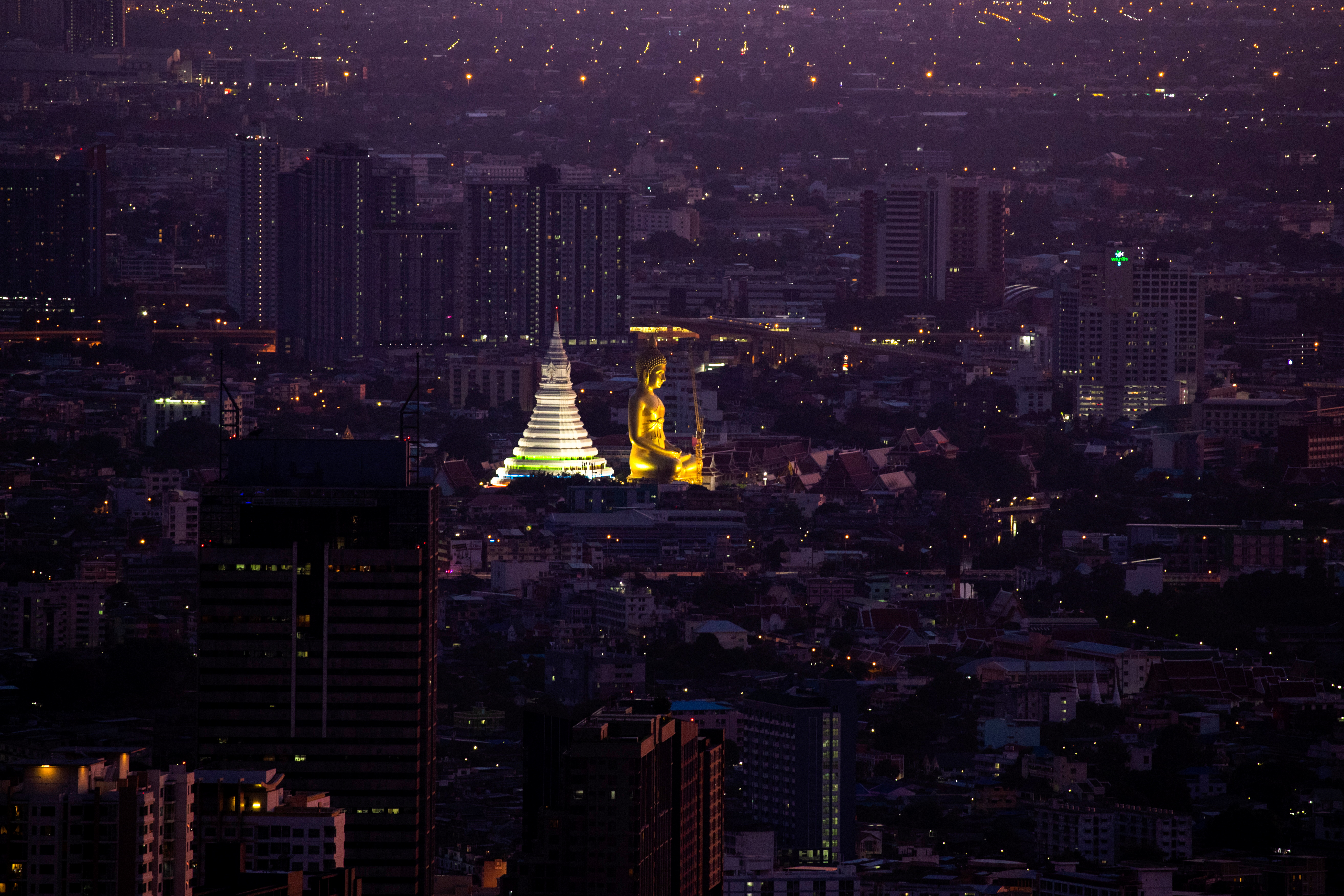 The giant Buddha statue of Wat Paknam Phasi Charoen temple is seen during sunset in Bangkok, Thailand, June 2, 2021. Picture taken June 2, 2021. REUTERS/Athit Perawongmetha