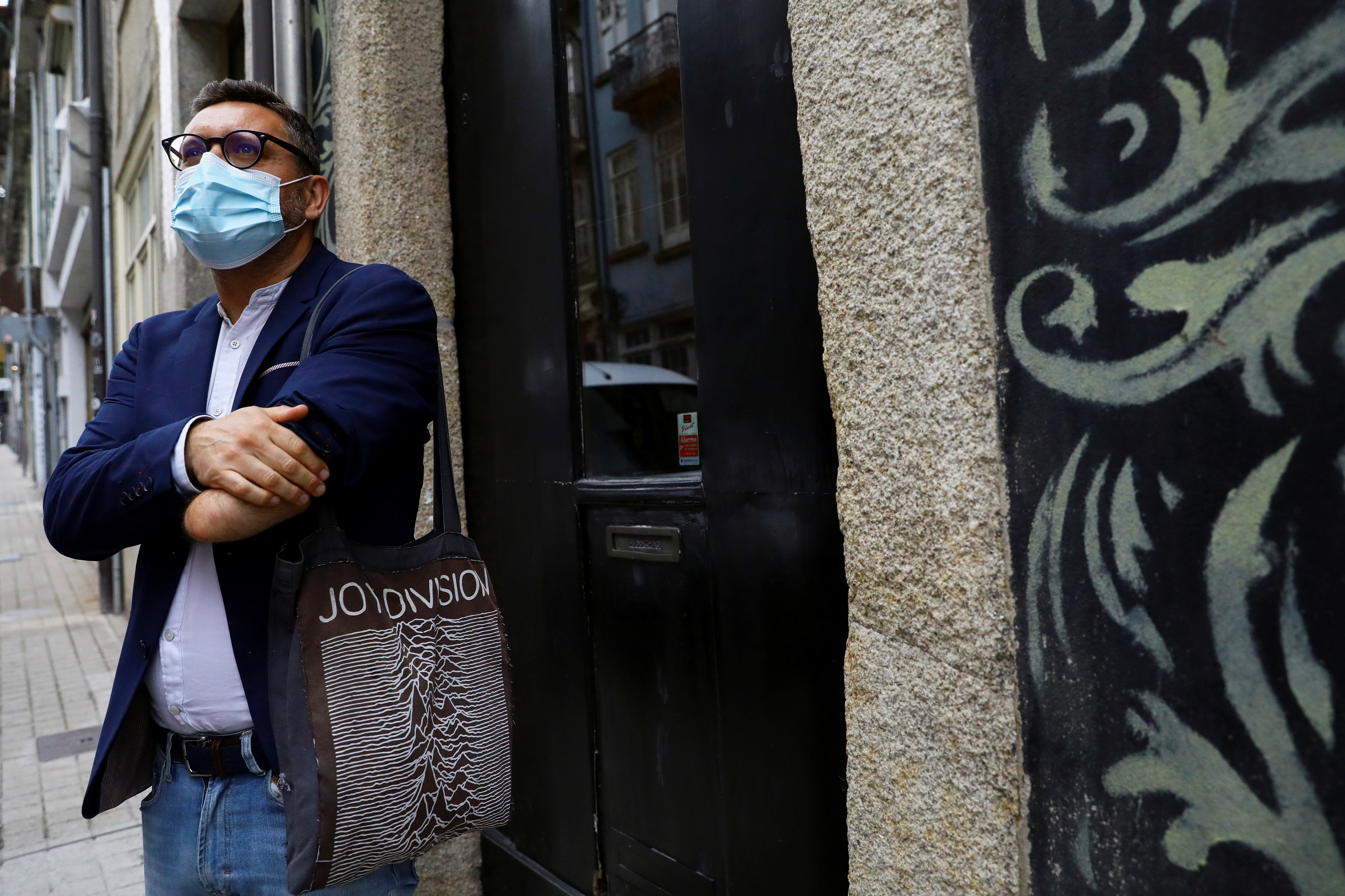 Rui Brito, a worker with a disability who lost his arm in a machinery accident more than 30 years ago, stands  outside a cafe after work amid the coronavirus disease (COVID-19) pandemic in Porto, Portugal, July 20, 2021. Picture taken July 20, 2021. REUTERS/Violeta Santos Moura
