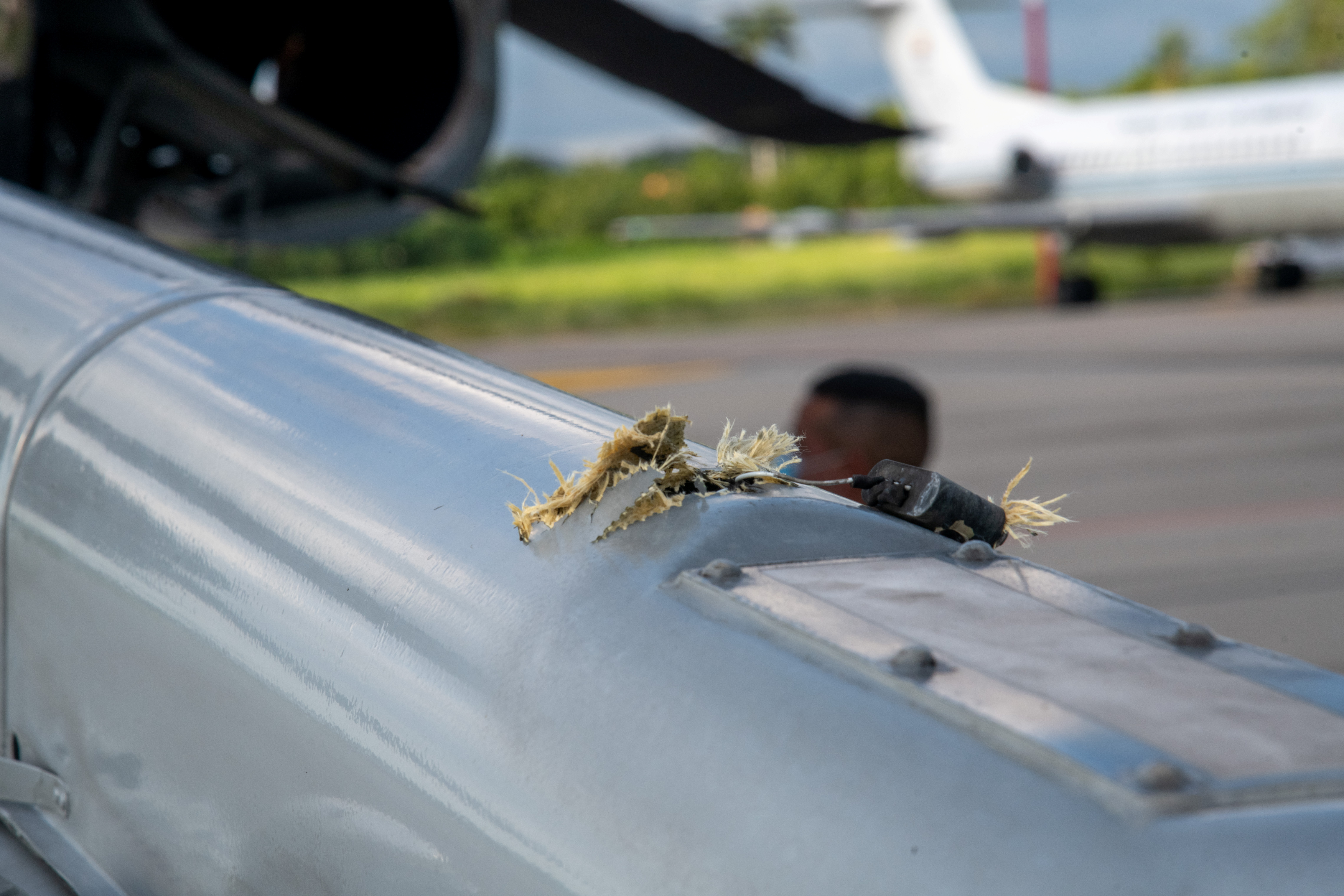 The mark of a projectile impact is seen on a helicopter that Colombian President Ivan Duque was traveling in, after it suffered an attack during an overflight, according to authorities, in Cucuta, Colombia June 25, 2021. Colombia Presidency/Handout via REUTERS
