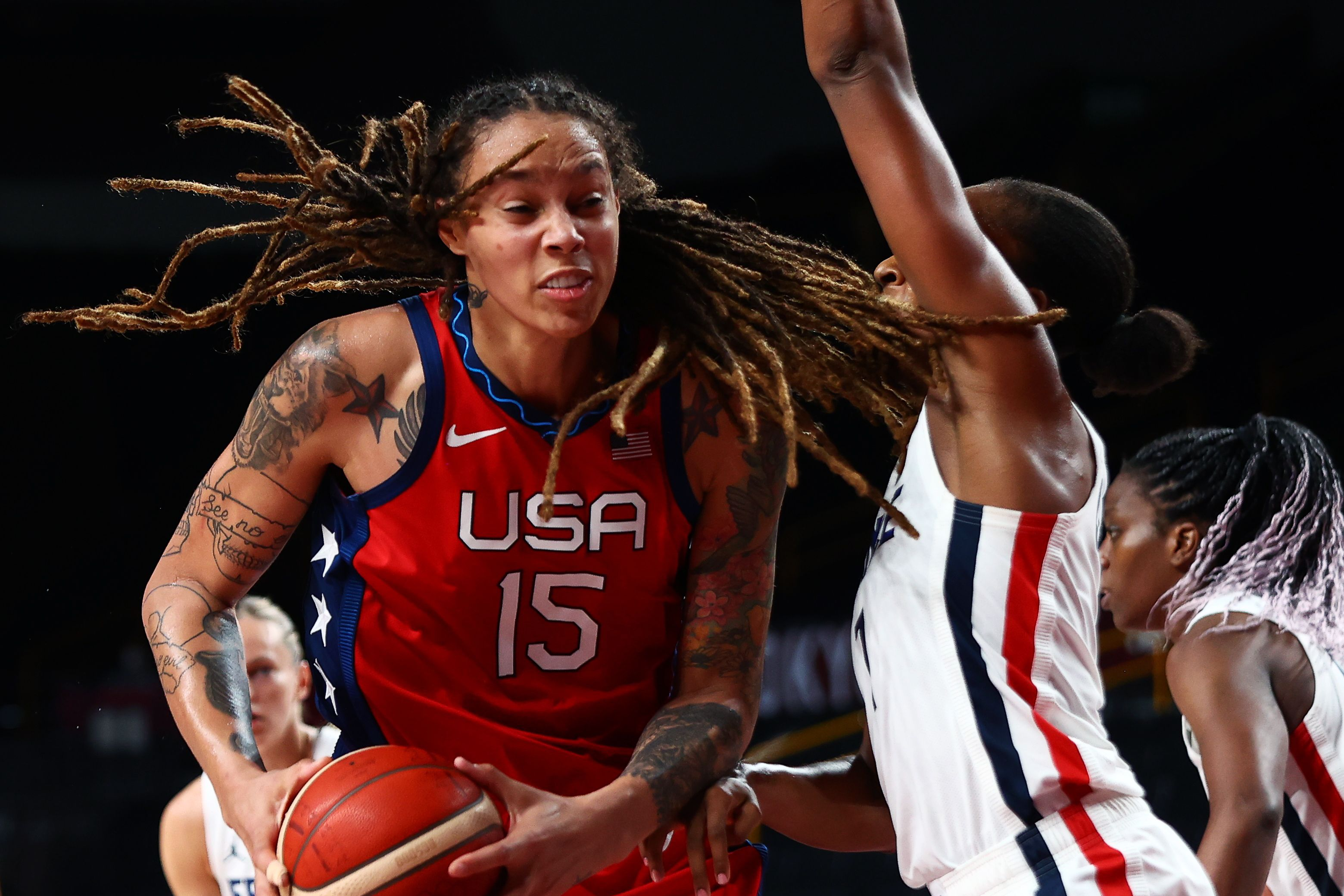 Tokyo 2020 Olympics - Basketball - Women - Group B - France v United States - Saitama Super Arena, Saitama, Japan - August 2, 2021. Brittney Griner of the United States in action with Sandrine Gruda of France REUTERS/Sergio Perez