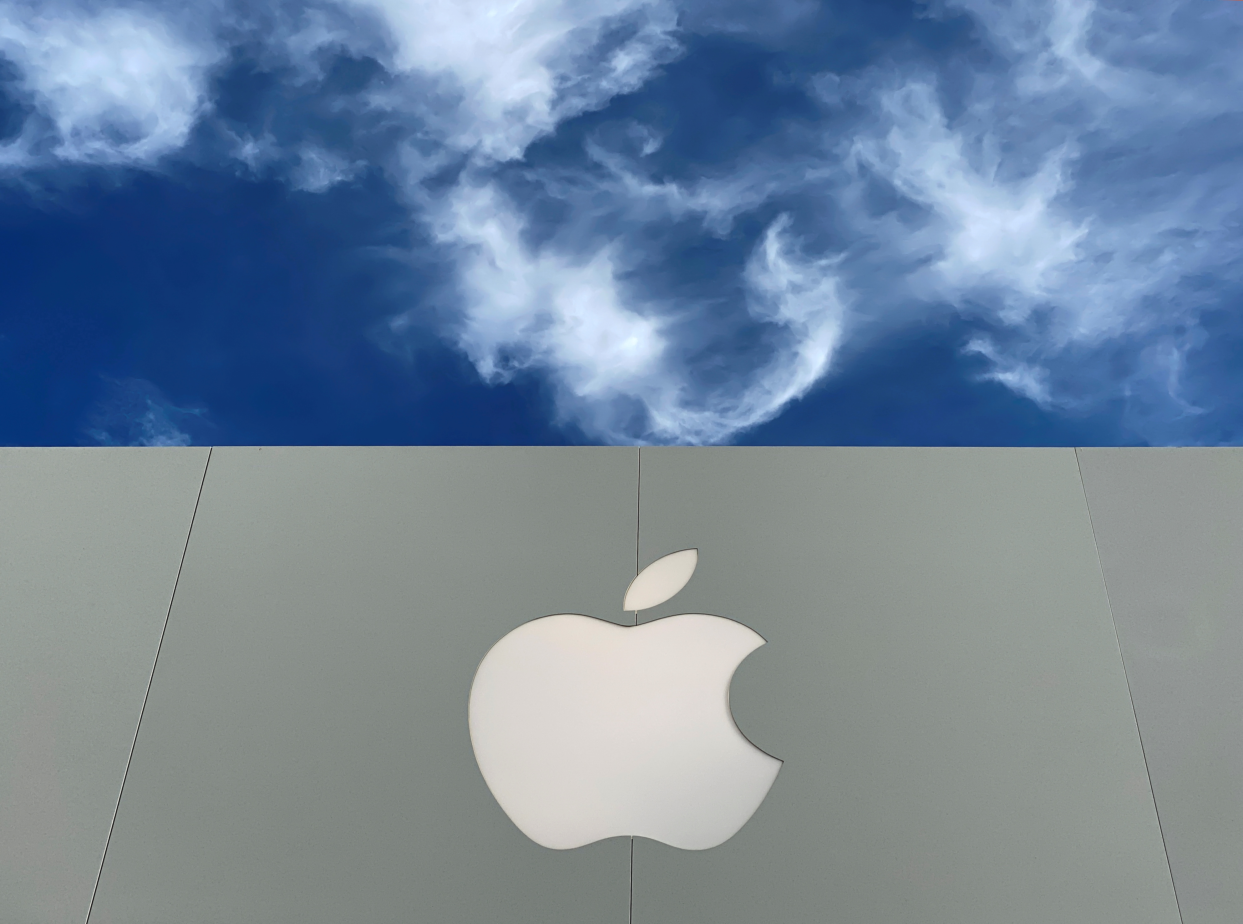 The Apple logo is shown atop an Apple store at a shopping mall in La Jolla, California, U.S., December 17, 2019.  REUTERS/Mike Blake/File Photo