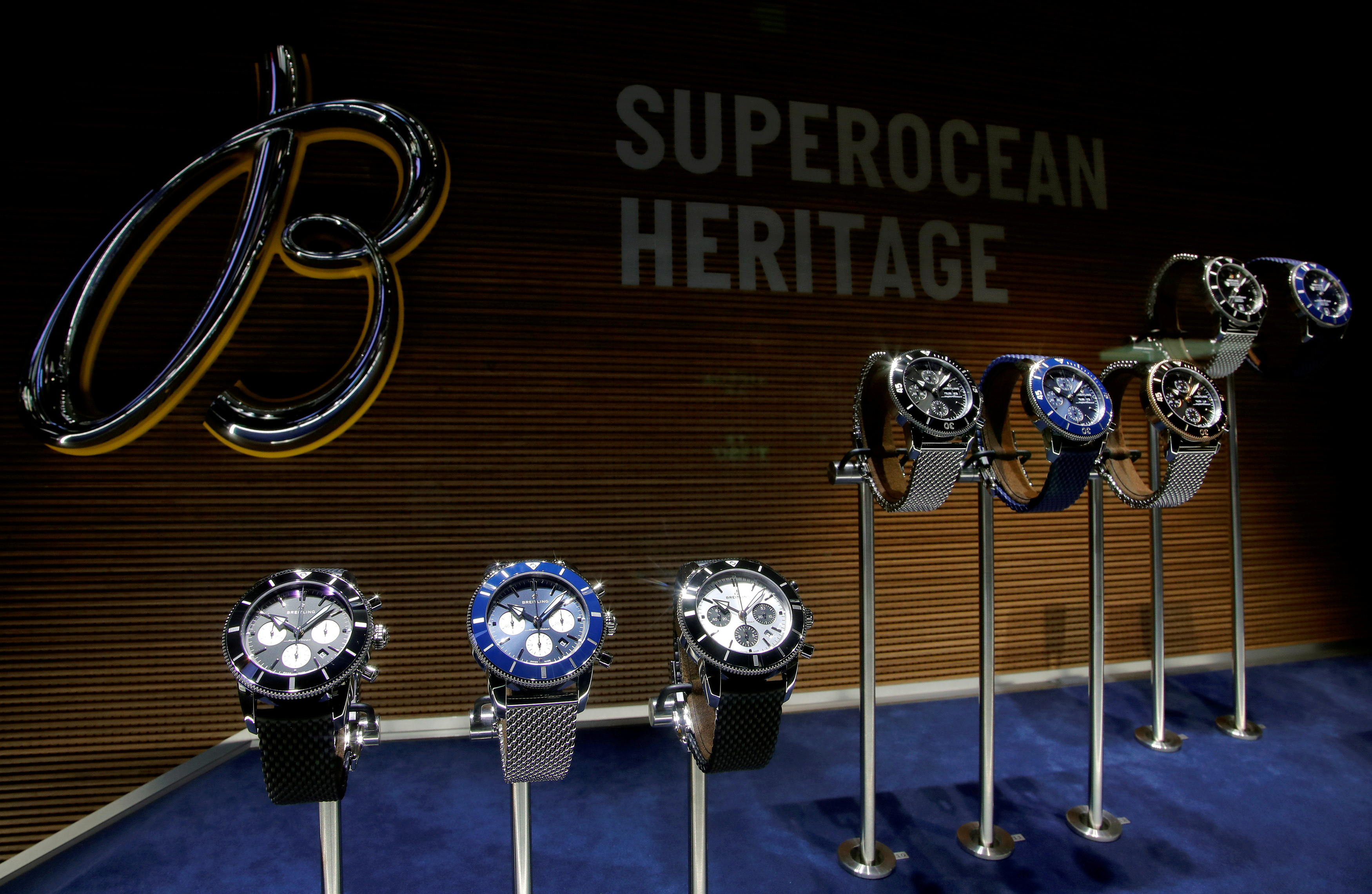 Superocean Heritage watches of Swiss watch manufacturer Breitling are displayed at the Baselworld watch and jewellery fair in Basel, Switzerland, March 21, 2018.  REUTERS/Arnd Wiegmann/File Photo