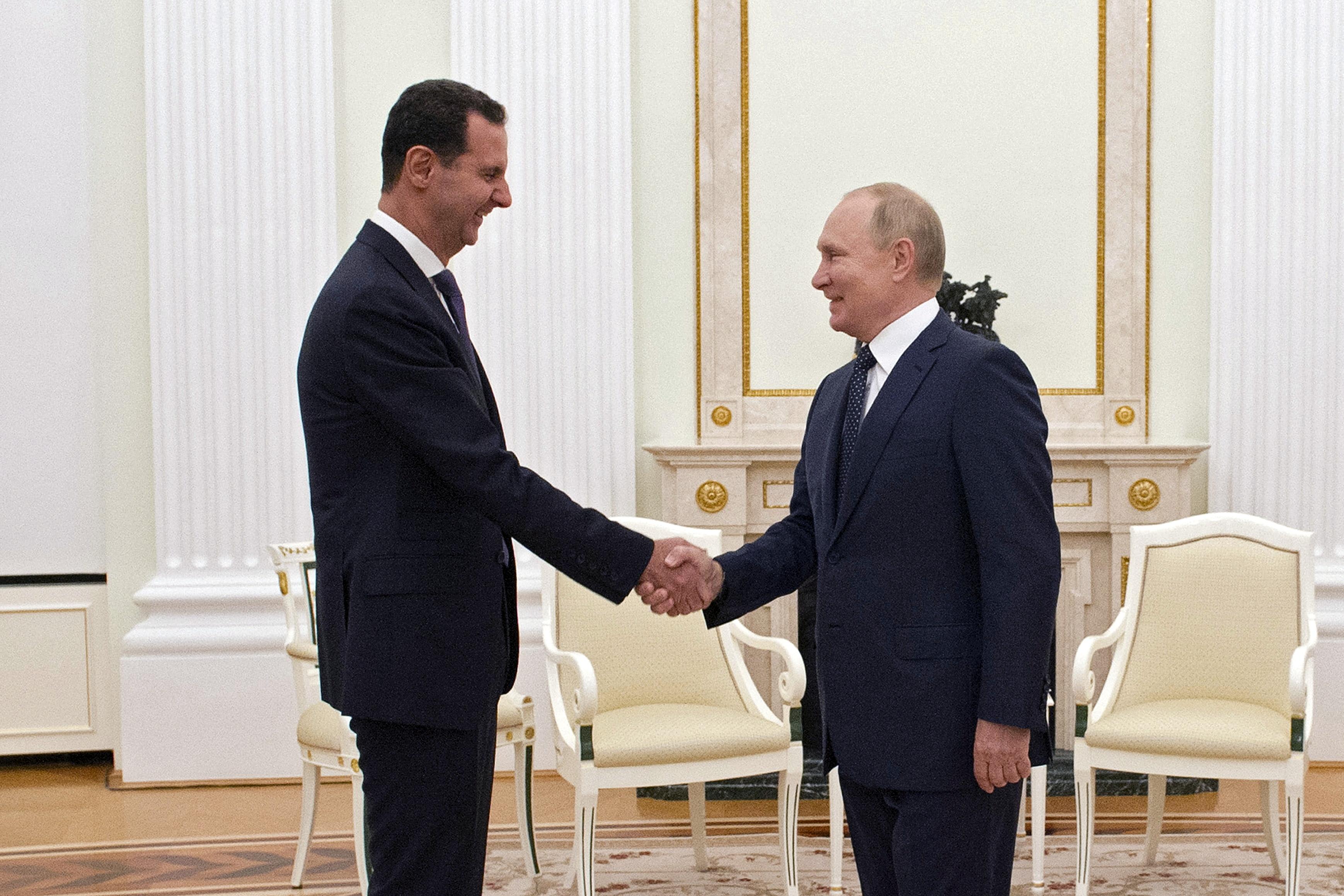 Russian President Vladimir Putin shakes hands with Syrian President Bashar al-Assad during a meeting at the Kremlin in Moscow, Russia, September 13, 2021. Picture taken September 13, 2021. Sputnik/Mikhail Klimentyev/Kremlin via REUTERS
