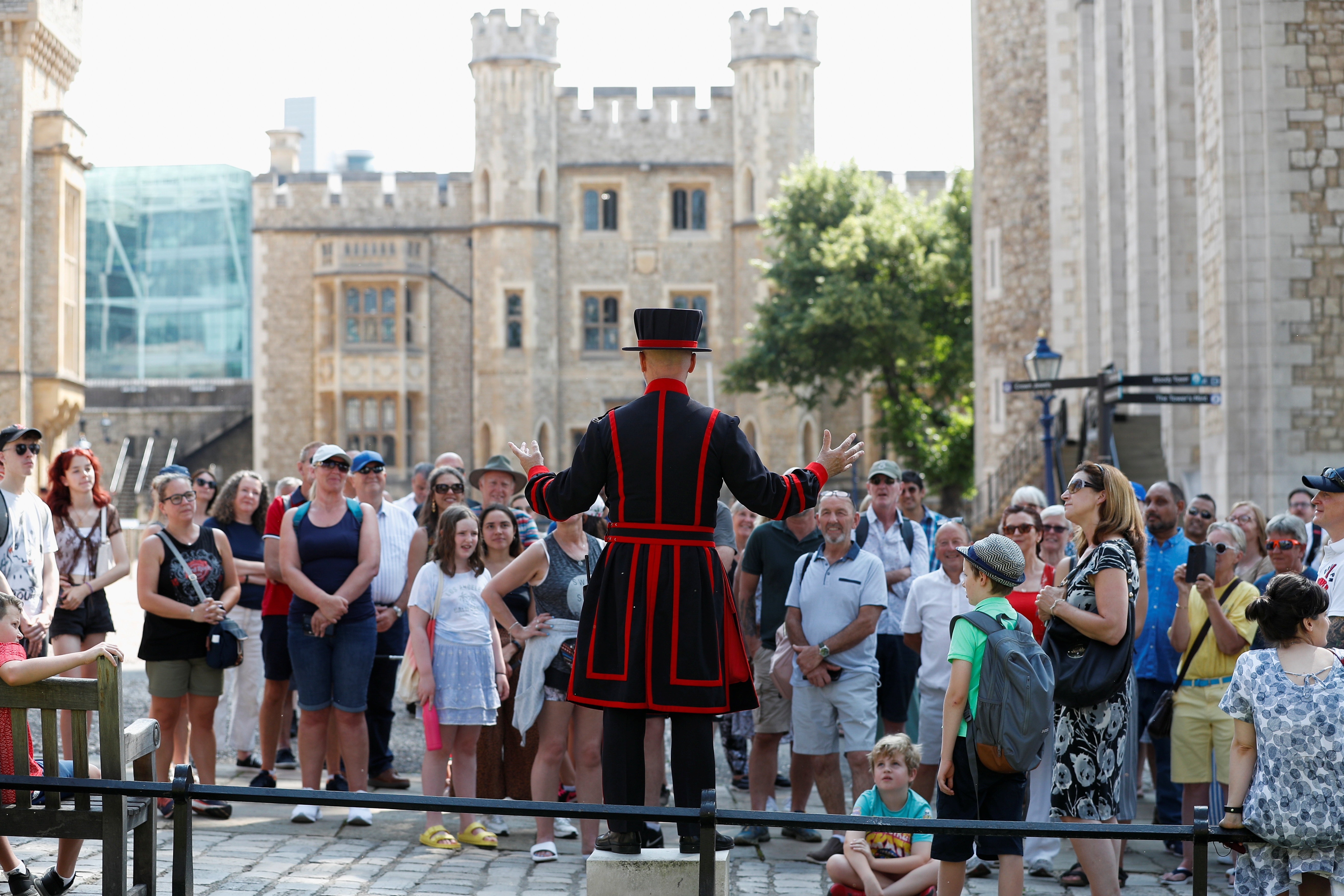 A Yeoman Warder, Barney Chandler speaks to the group, as he leads the first