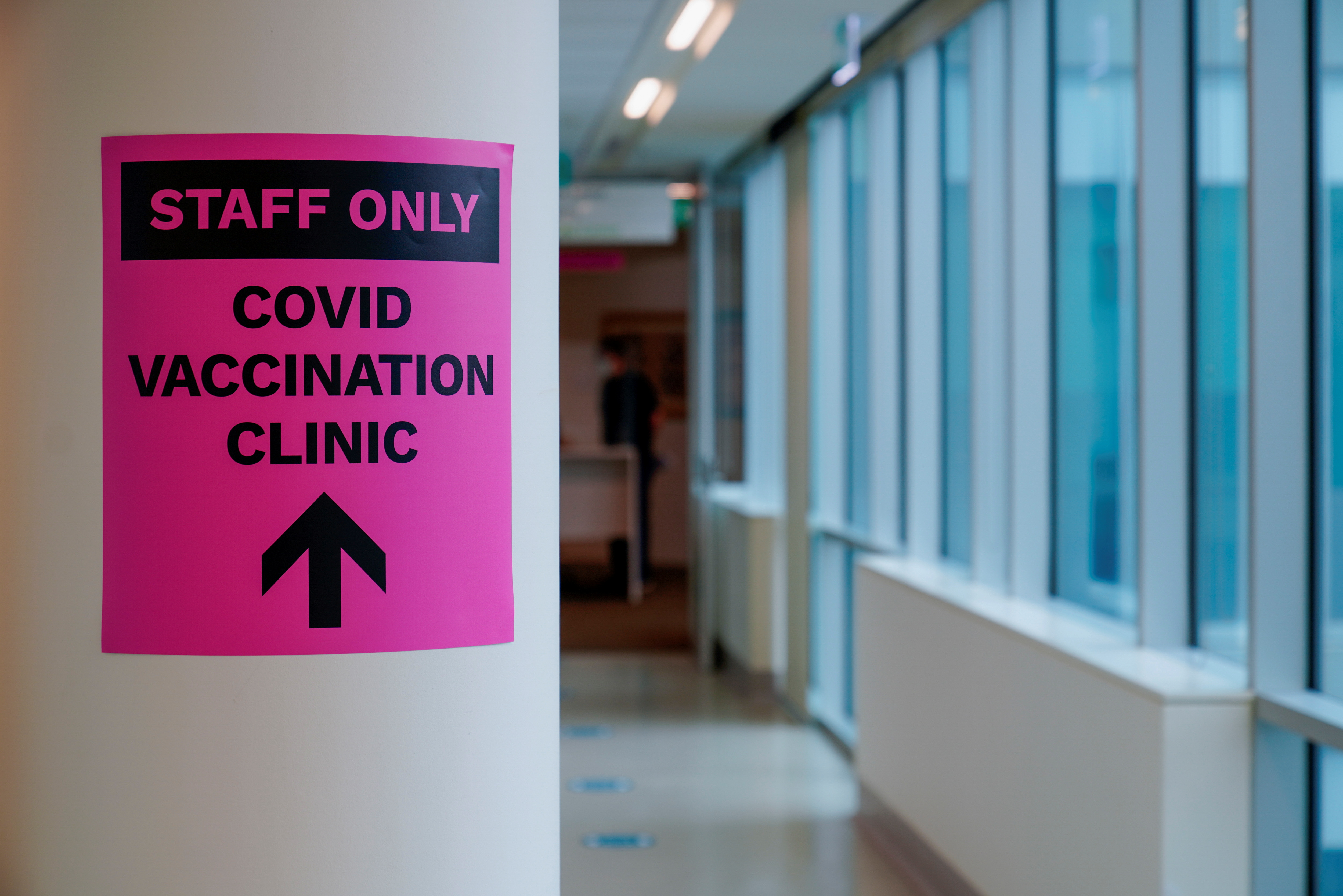 A sign for a COVID-19 vaccination clinic is seen as high-risk workers receive the first vaccines in the state of Victoria's rollout of the program, in Melbourne, Australia, February 22, 2021.  REUTERS/Sandra Sanders