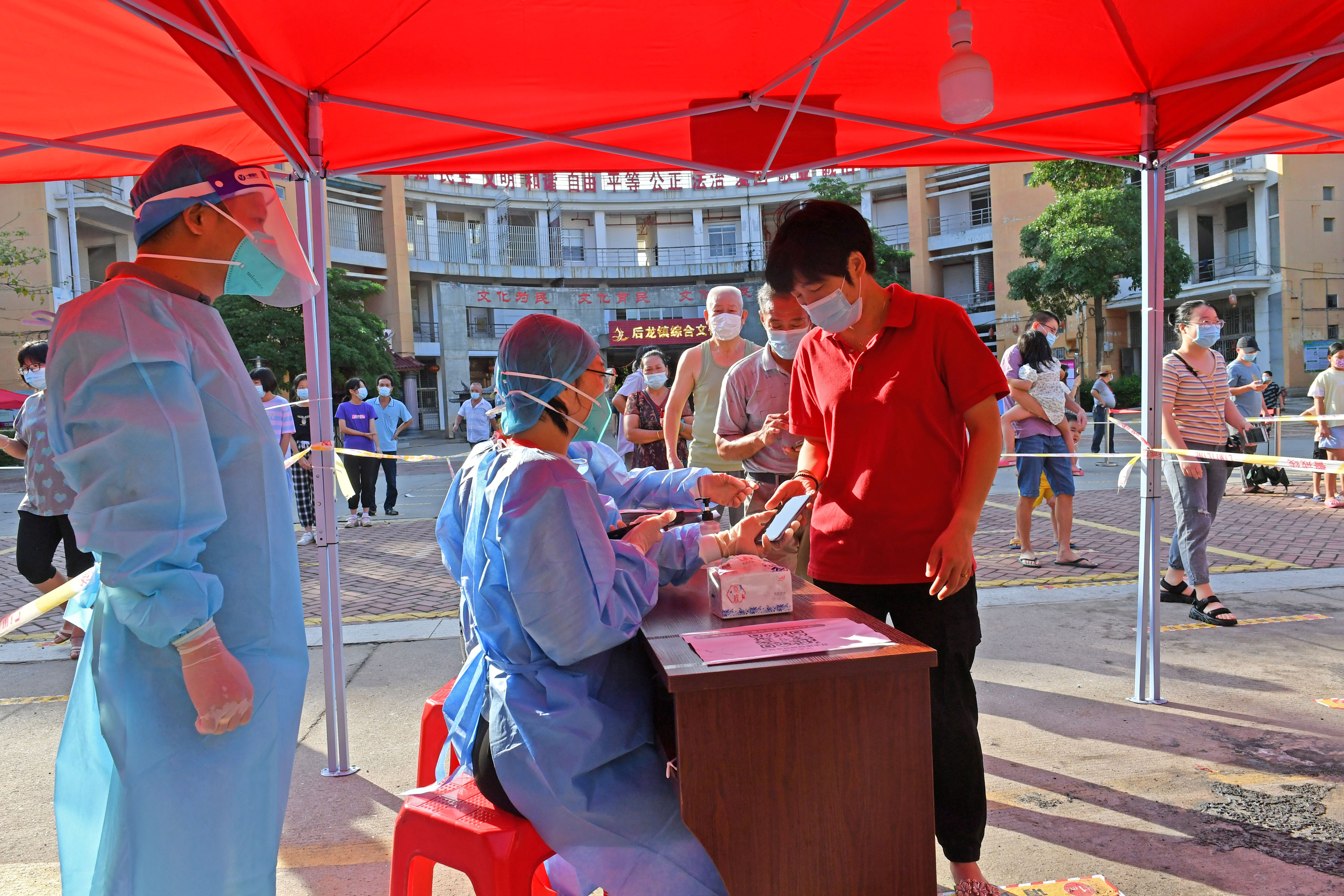 Residents register to take nucleic acid tests at a testing site in Quanzhou, following new cases of the coronavirus disease (COVID-19), in Fujian province, China September 13, 2021.  China Daily via REUTERS ATTENTION EDITORS - THIS IMAGE WAS PROVIDED BY A THIRD PARTY. CHINA OUT.