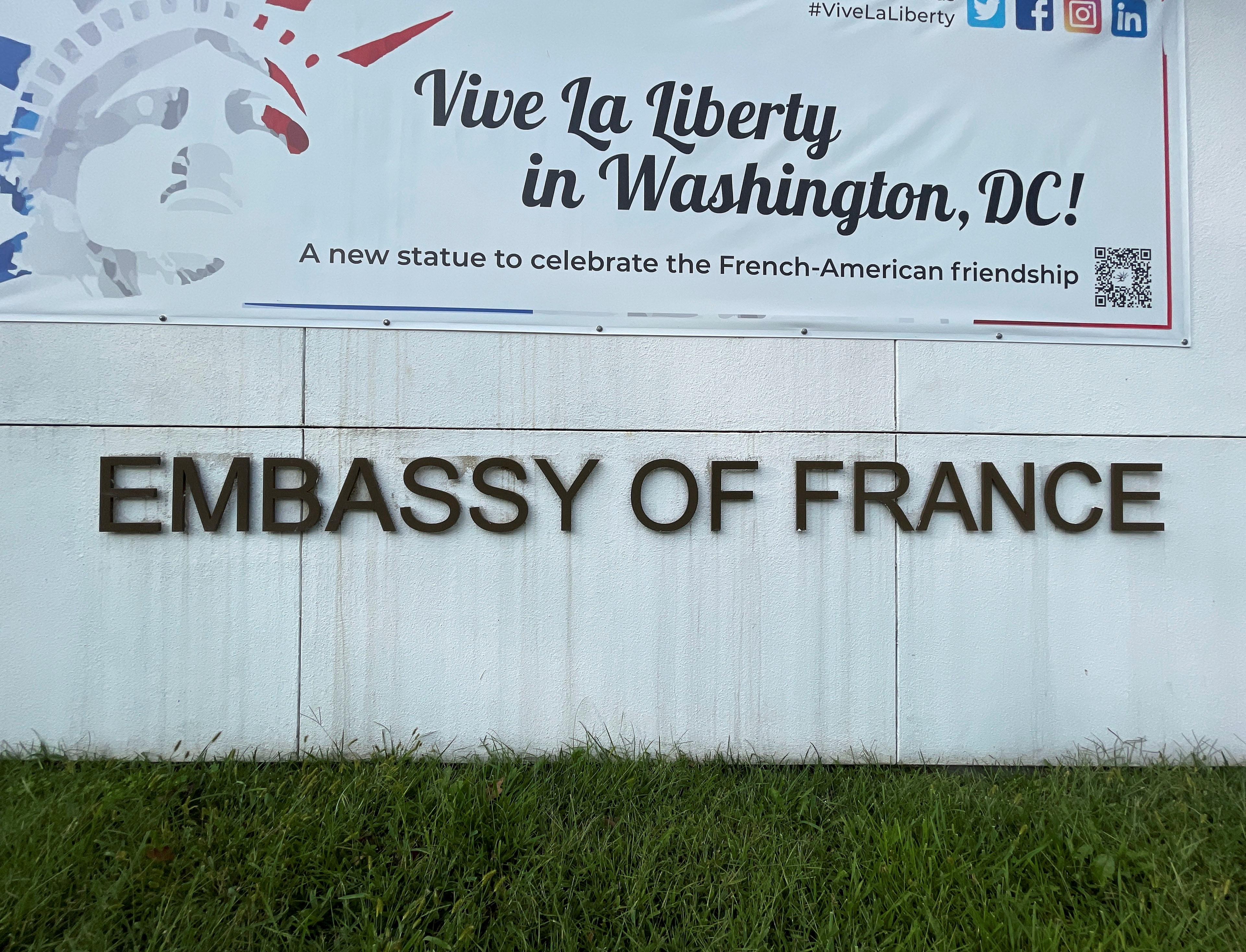 A sign outside the French Embassy is seen after it was announced France decided to recall its ambassadors in the United States and Australia for consultations after Australia struck a deal with the U.S. and Britain which ended a $40 billion French-designed submarine deal, in Washington, U.S., September 17, 2021. REUTERS/Gershon Peaks