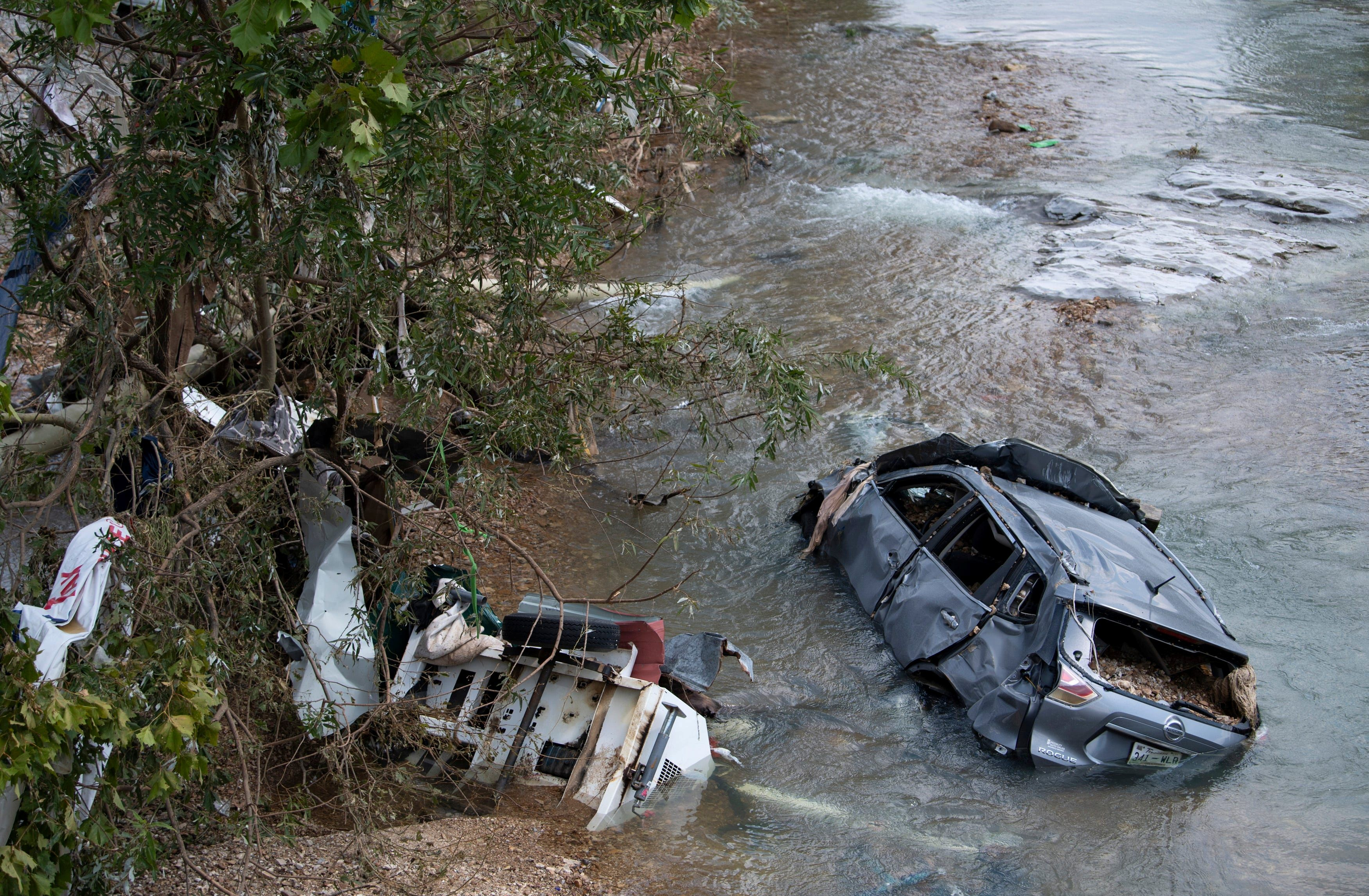 A flooded car and debris are seen after flooding in Trace Creek, Waverly, Tennessee, U.S., August 23, 2021. George Walker IV/The Tennessean/USA Today via REUTERS