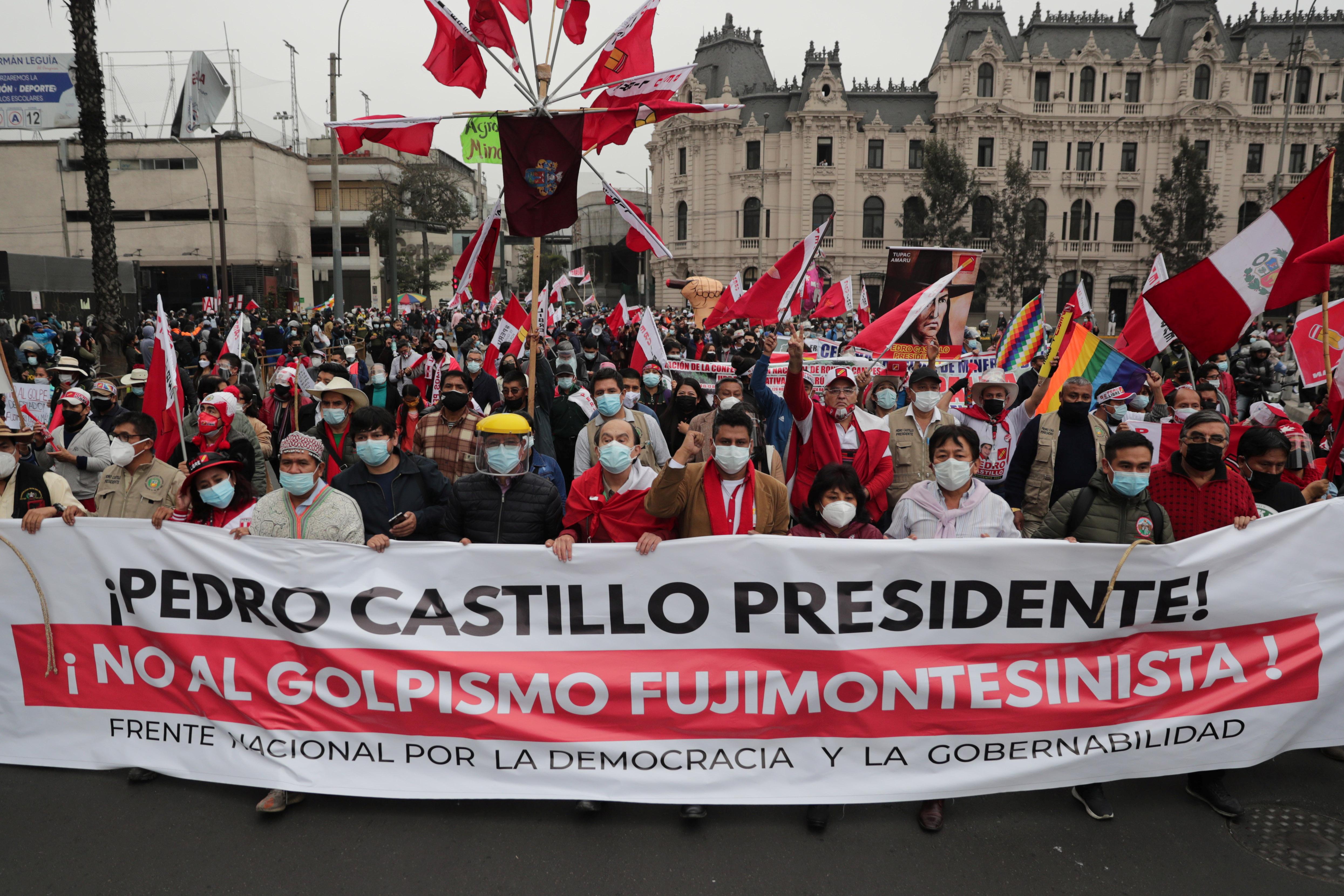 "Supporters of Peru's presidential candidate Pedro Castillo hold a banner reading ""President Pedro Castillo. No to the Fujimori/Montesinos coup"" in Lima, Peru June 26, 2021. REUTERS/Sebastian Castaneda"