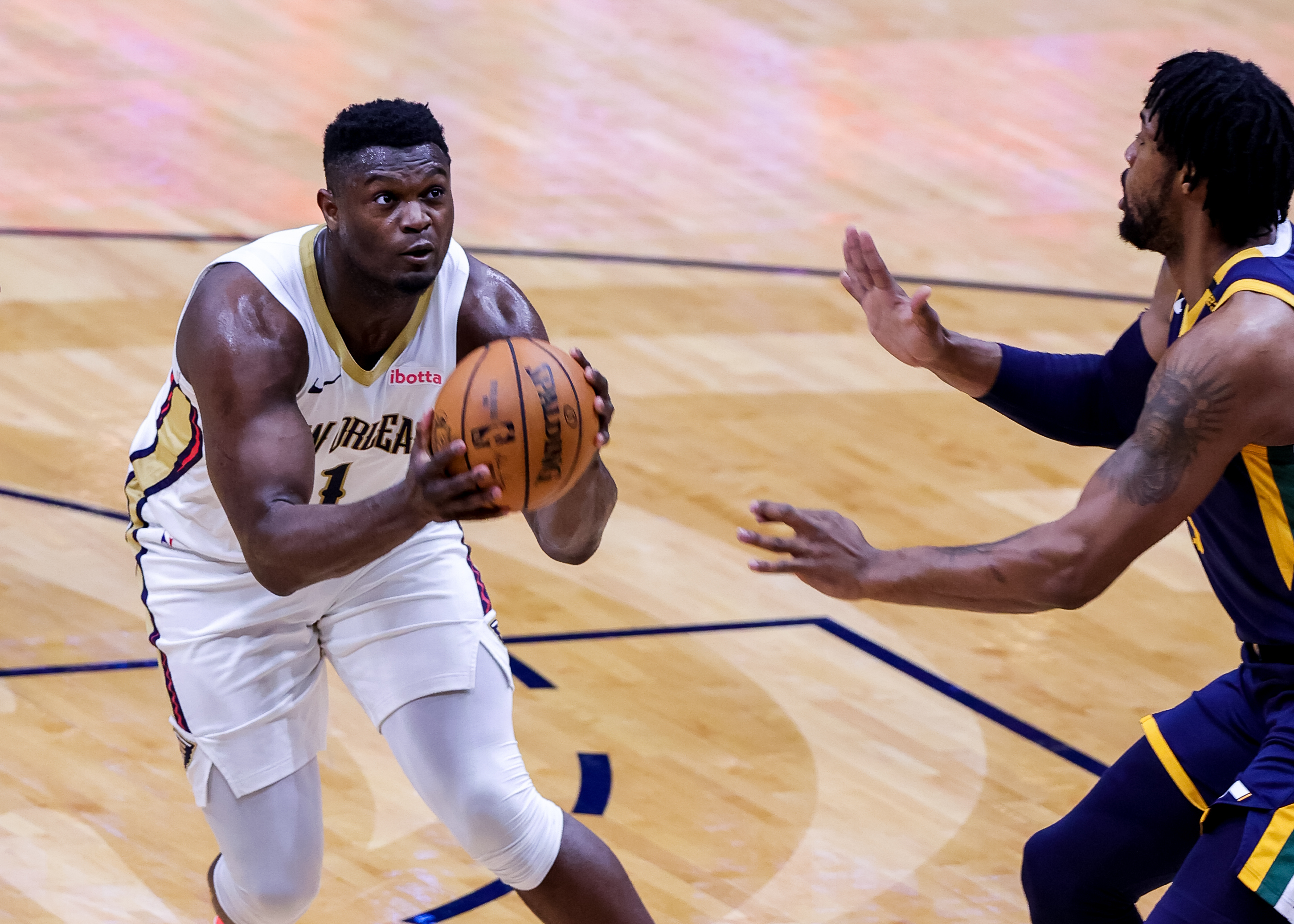 Mar 1, 2021; New Orleans, Louisiana, USA;  New Orleans Pelicans forward Zion Williamson (1) drives to the basket against Utah Jazz center Derrick Favors (right) during the first half at the Smoothie King Center. Mandatory Credit: Stephen Lew-USA TODAY Sports