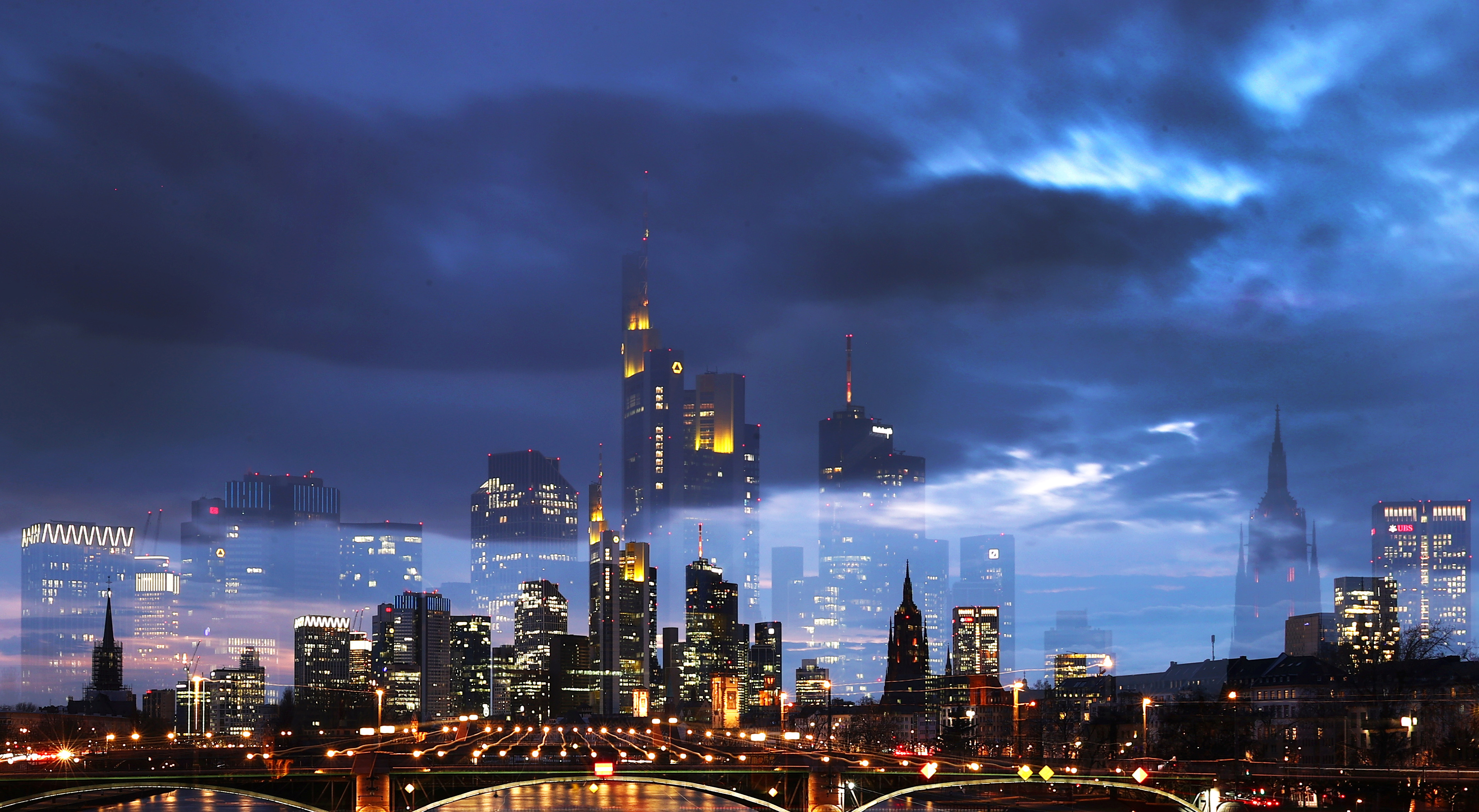 Dark clouds hang over the financial district as the spread of the coronavirus disease (COVID-19) continues in Frankfurt, Germany, March 16, 2021. Picture taken with long exposure. REUTERS/Kai Pfaffenbach