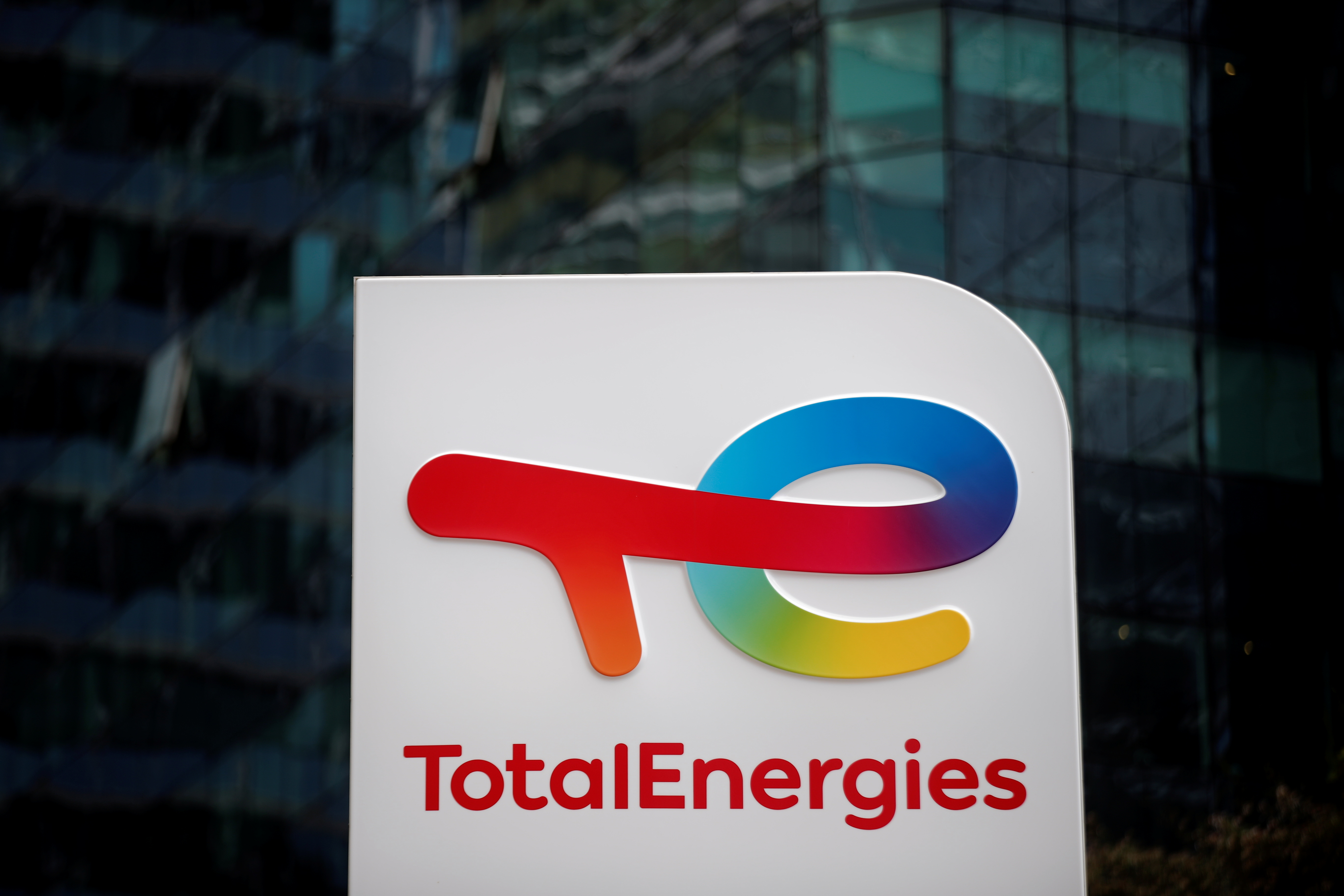 A general view of logo at the TotalEnergies electric vehicle fuelling station in the La Defense business district in Paris, France, July 28, 2021. REUTERS/Benoit Tessier
