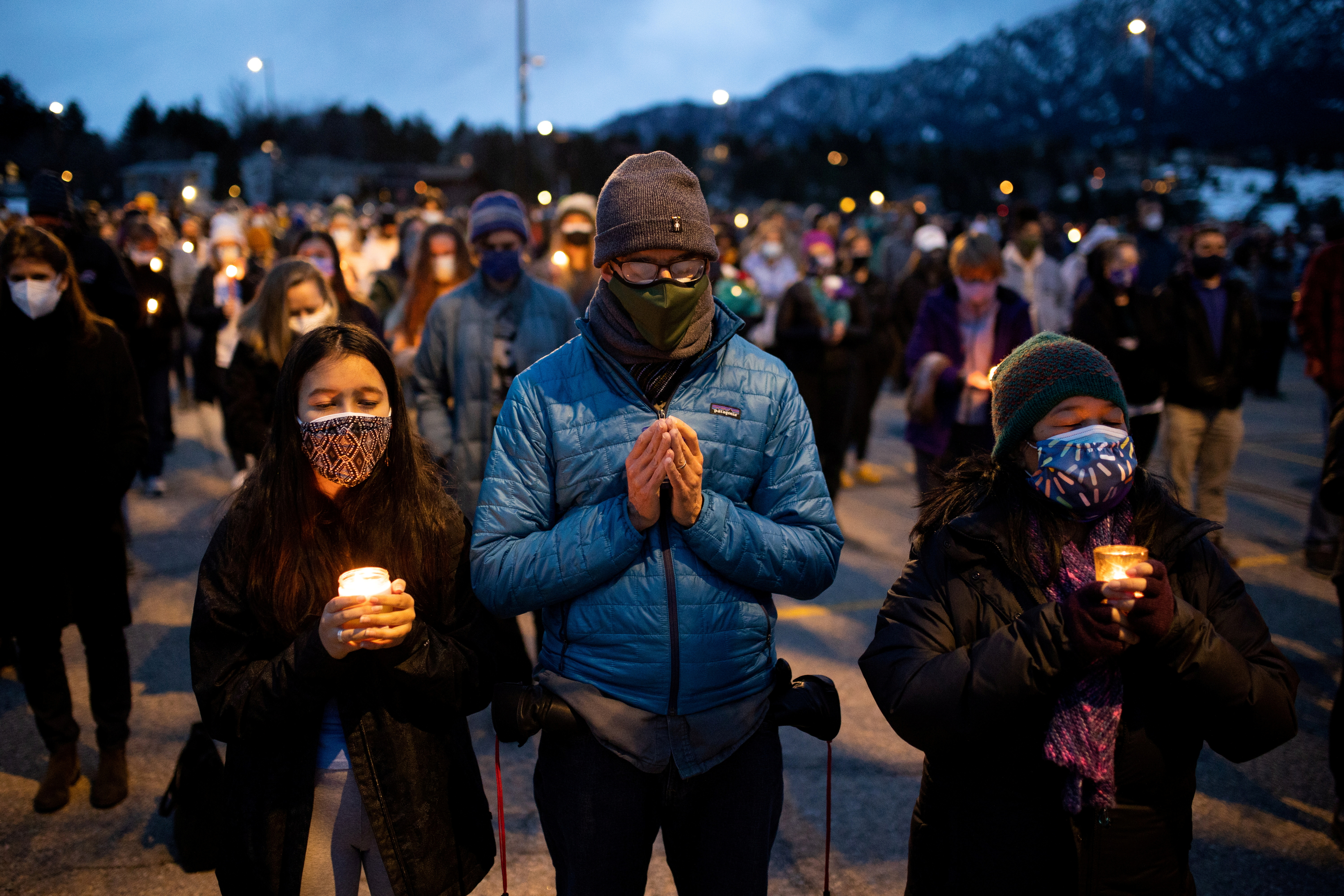 Hundreds gather at Fairview High School for a candlelight vigil to remember the victims of a mass shooting that left 10 dead at King Soopers grocery store in Boulder, Colorado, U.S. March 25, 2021.  REUTERS/Alyson McClaran