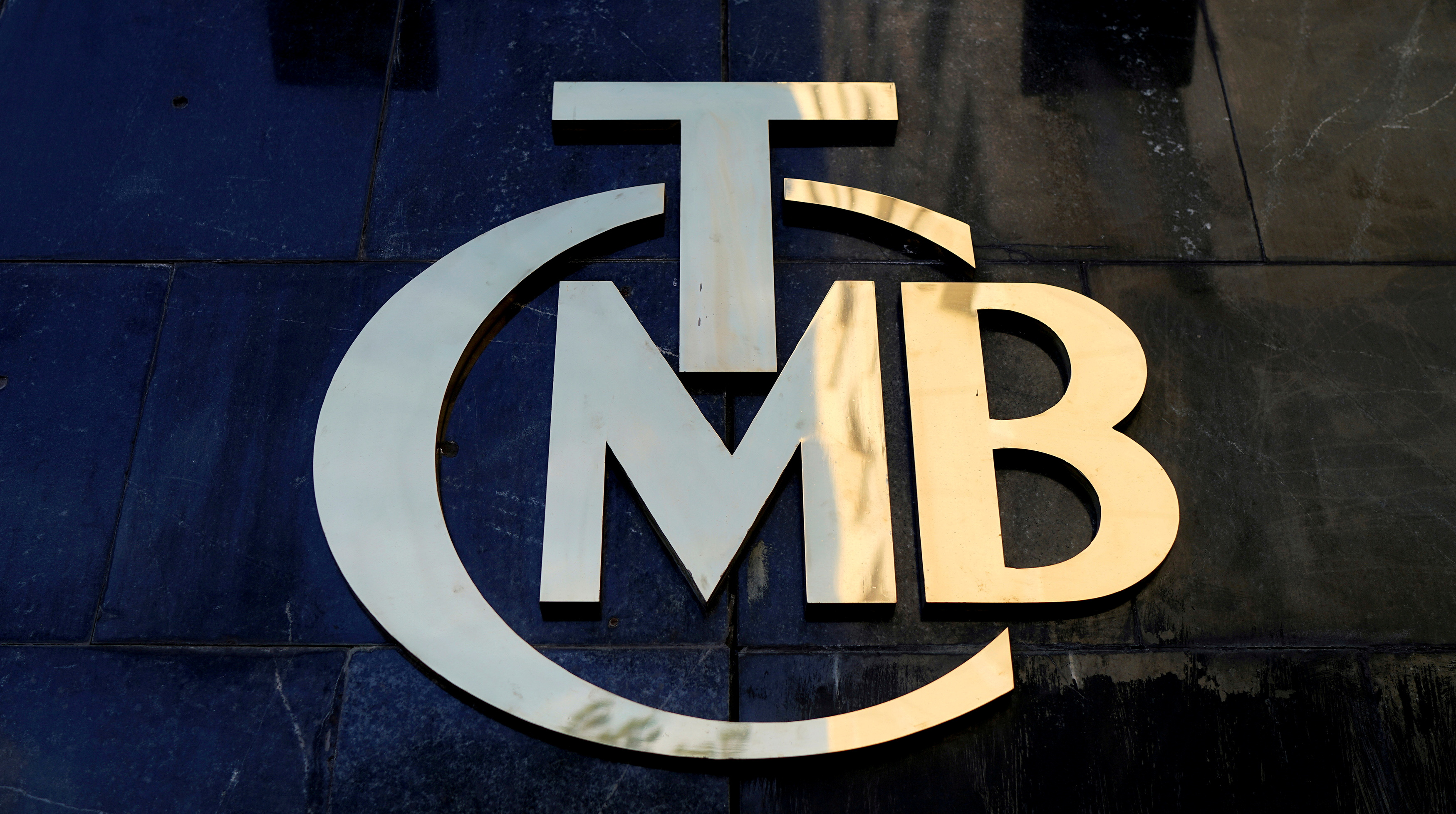A logo of Turkey's Central Bank (TCMB) is pictured at the entrance of the bank's headquarters in Ankara, Turkey April 19, 2015. REUTERS/Umit Bektas