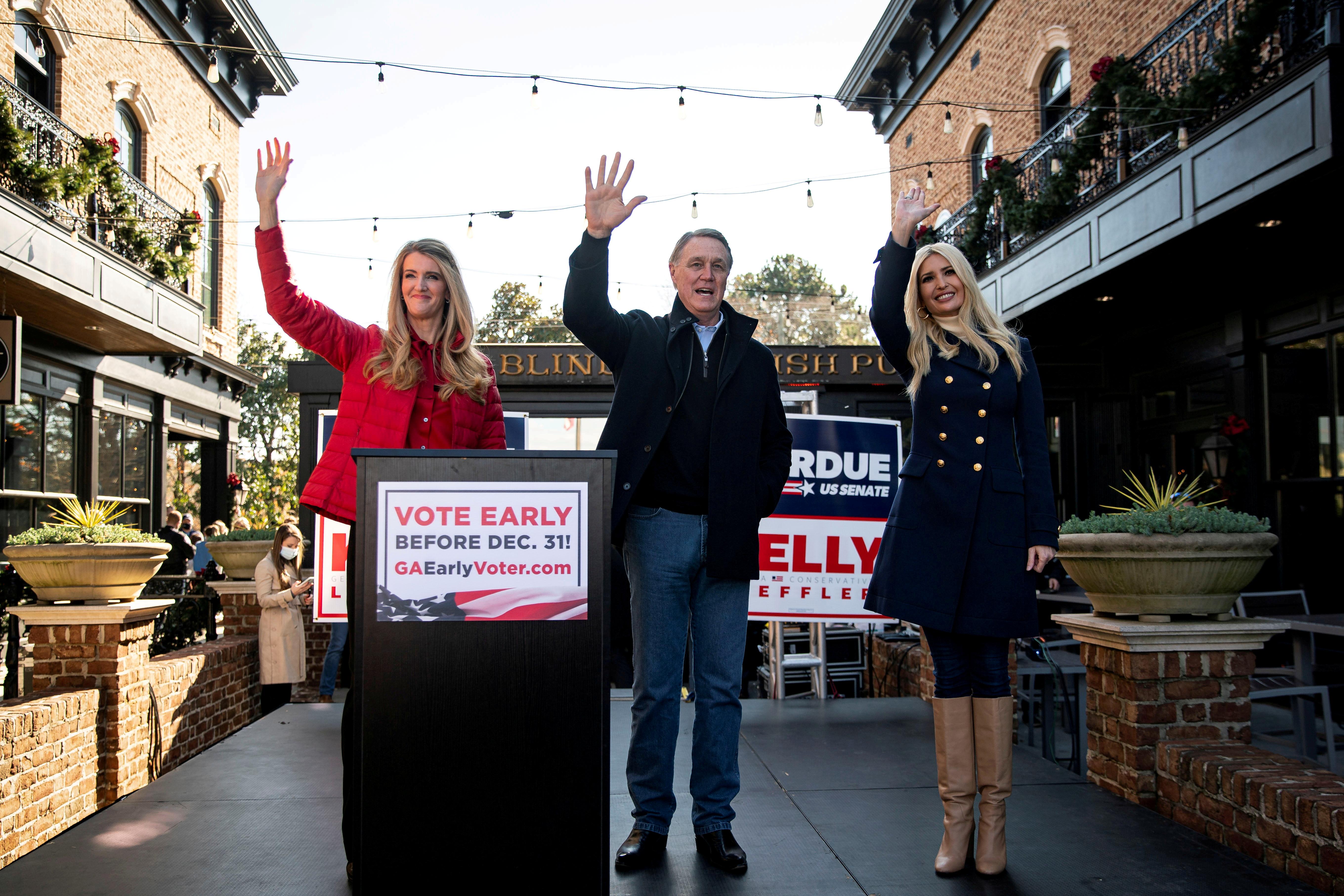 Senator Kelly Loeffler (R-GA), Senator David Perdue (R-GA), and White House senior adviser Ivanka Trump wave during a campaign event at the Olde Blind Dog Irish Pub, in Milton, Georgia, U.S., December 21, 2020.REUTERS/Al Drago