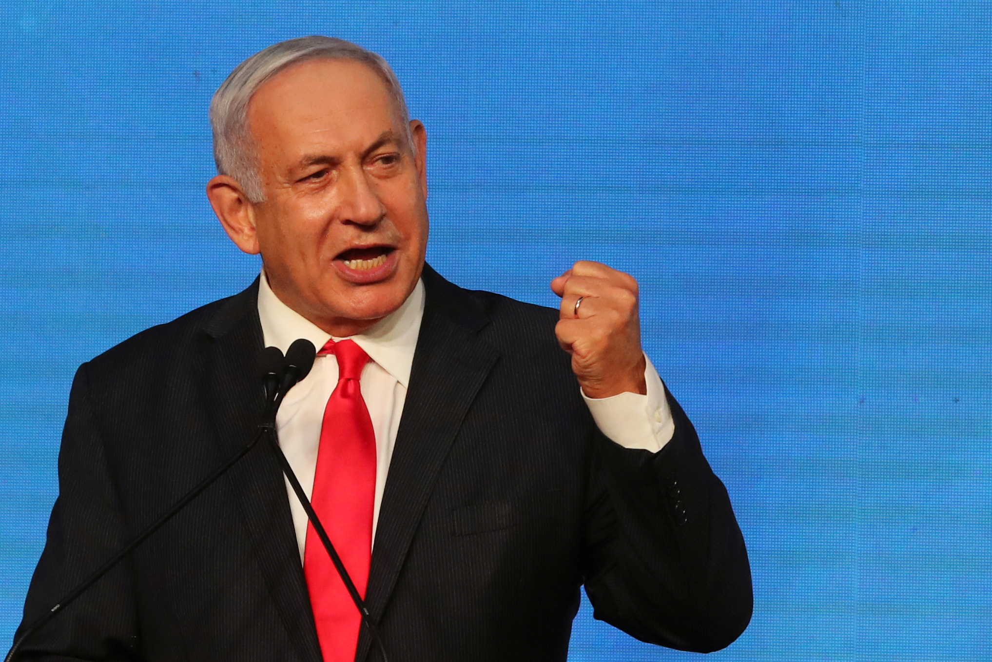 Israeli Prime Minister Benjamin Netanyahu gestures as he delivers a speech to supporters following the announcement of exit polls in Israel's general election at his Likud party headquarters in Jerusalem March 24, 2021. REUTERS/Ammar Awad