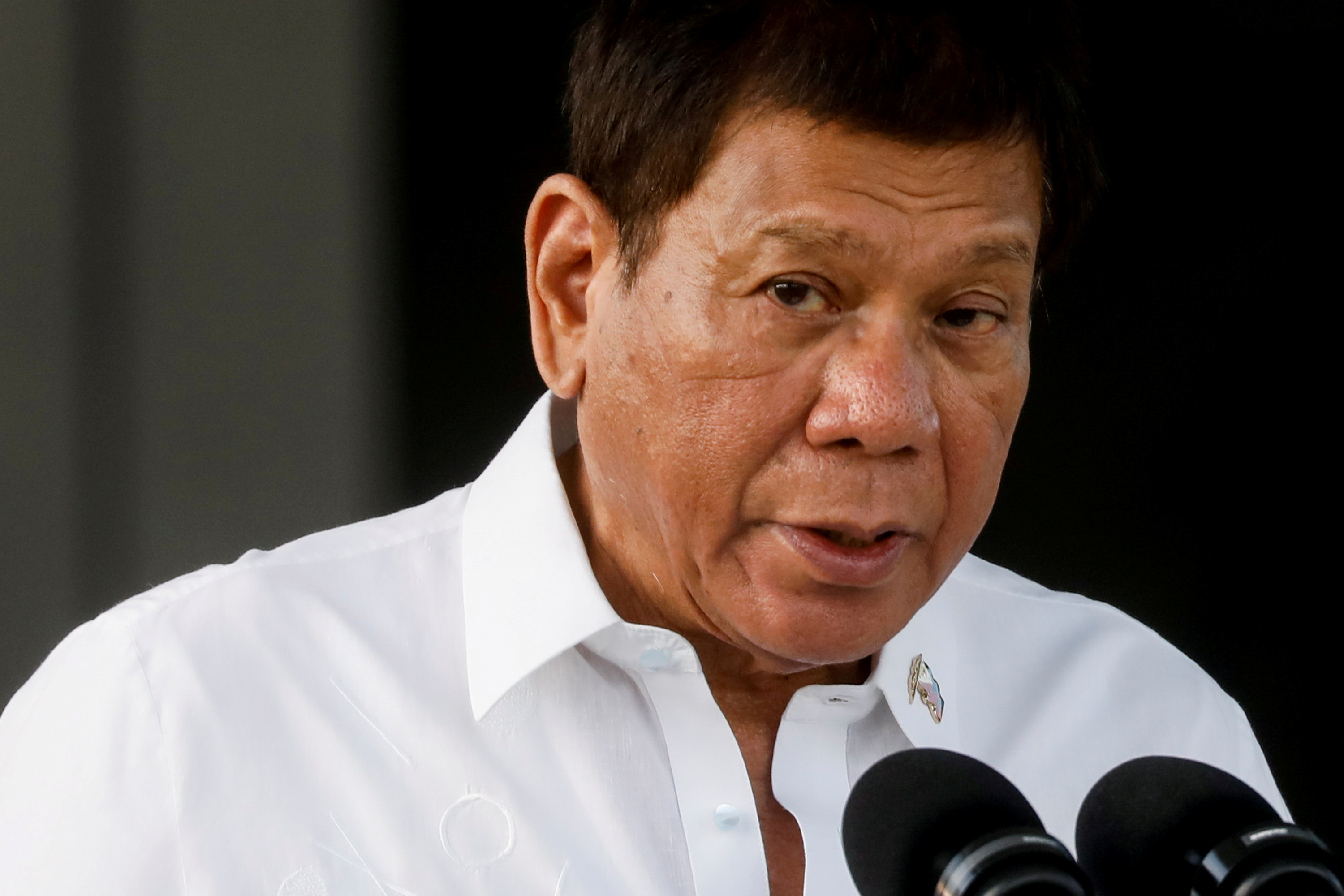 Philippine President Rodrigo Duterte speaks during the arrival ceremony for the first COVID-19 vaccines to arrive in the country, at Villamor Air Base in Pasay, Metro Manila, Philippines, February 28, 2021. REUTERS/Eloisa Lopez/File Photo