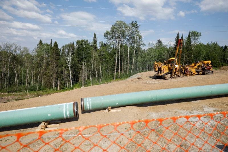 The Enbridge Line 3 pipeline is pictured in place to be buried near Park Rapids on the second day of the Treaty People Gathering, an organized protest of the Line 3 pipeline, built by Enbridge Energy, in Park Rapids, Minnesota, U.S., June 6, 2021. REUTERS/Nicholas Pfosi