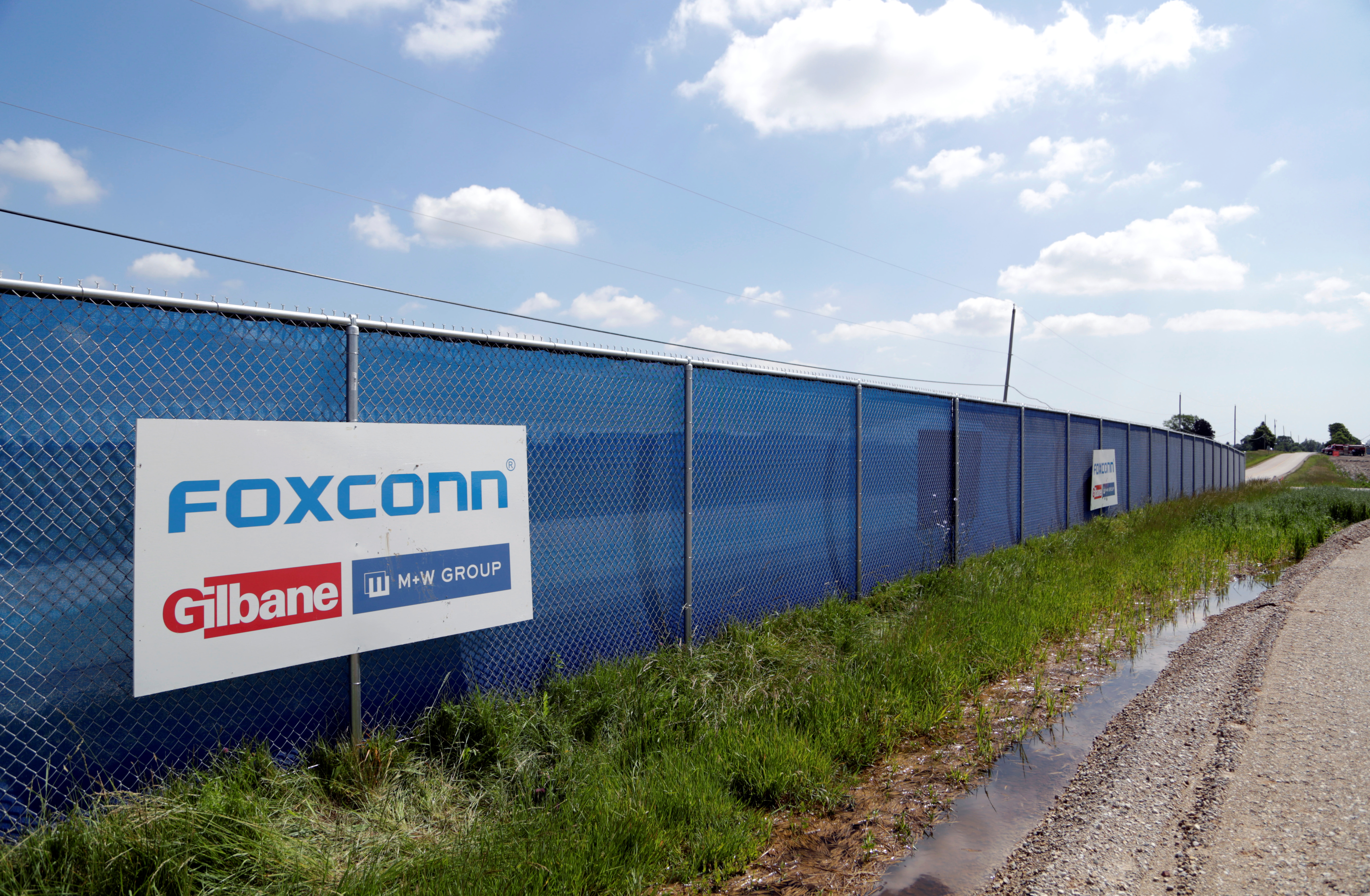 A FoxConn logo is seen before the arrival of U.S. President Donald Trump as he participates in the Foxconn Technology Group groundbreaking ceremony for its LCD manufacturing campus, in Mount Pleasant, Wisconsin, U.S., June 28, 2018.  REUTERS/Darren Hauck/Files