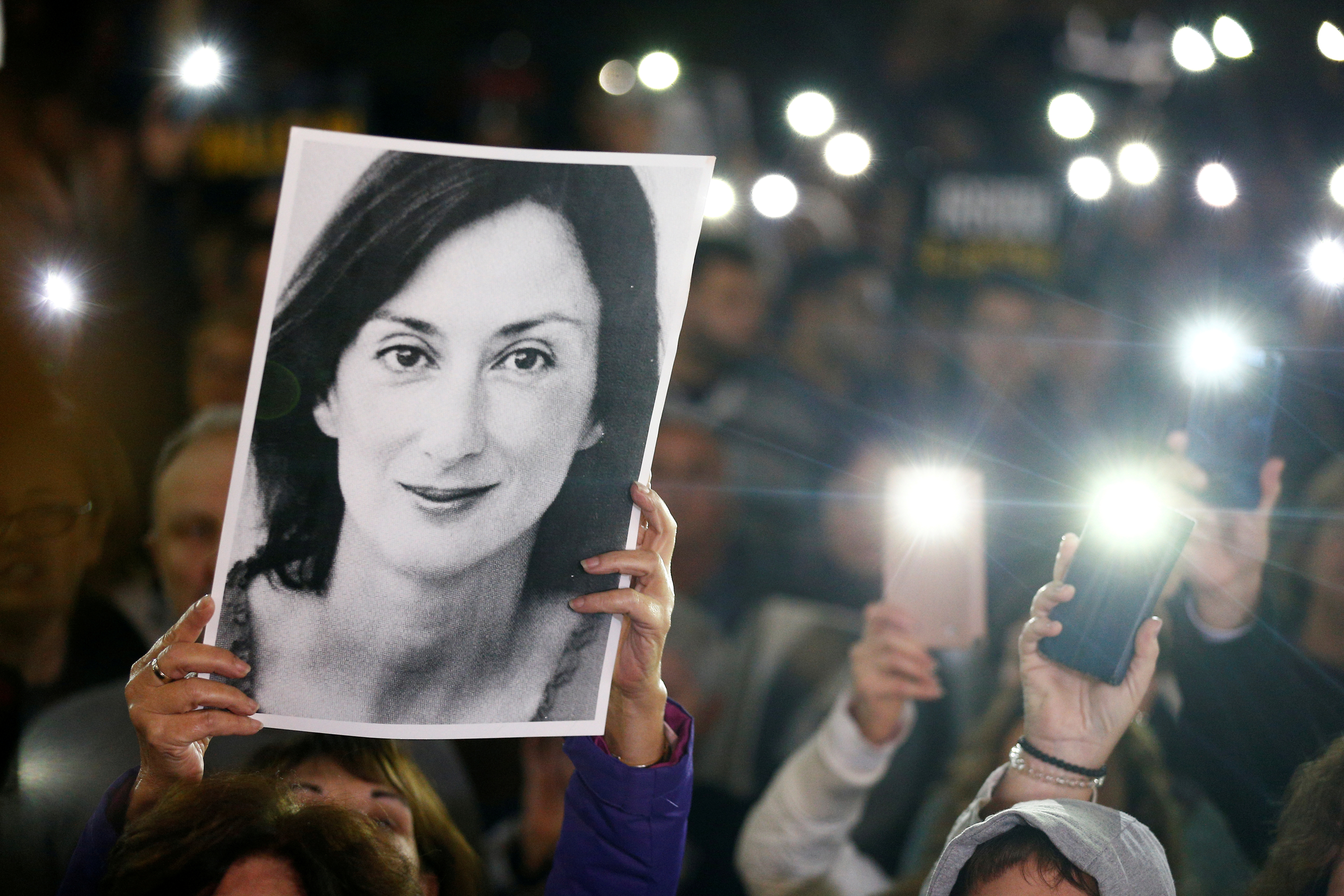 People gather at the Great Siege Square calling for the resignation of Joseph Muscat following the arrest of one of the country's most prominent businessmen as part of the investigation into the murder of journalist Daphne Caruana Galizia, in Valletta, Malta November 20, 2019. REUTERS/Guglielmo Mangiapane/File Photo