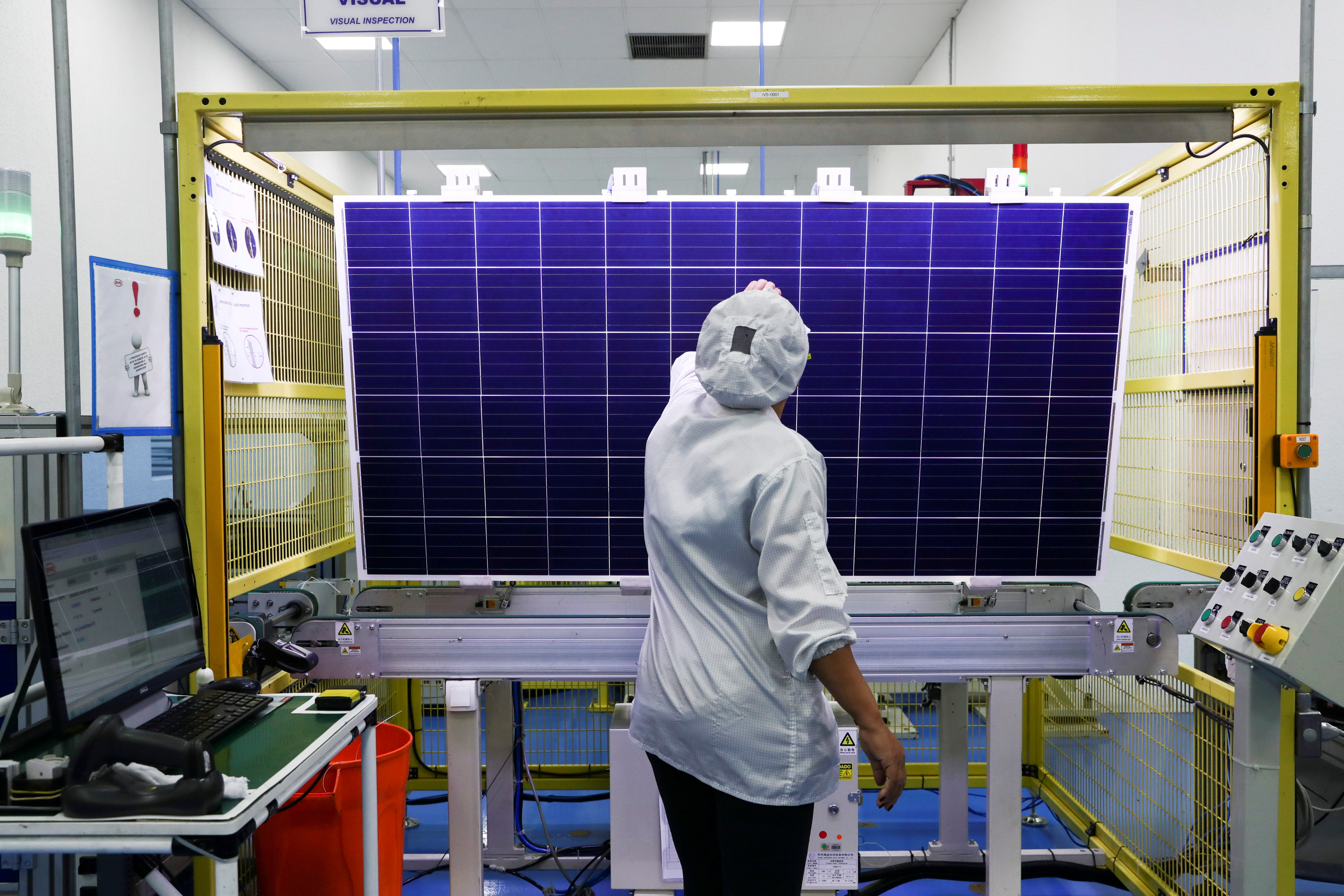 An employee conducts a quality-check of a solar module product at a factory of Chinese solar equipment manufacturer BYD in Campinas, Brazil February 13, 2020. Picture taken February 13, 2020. REUTERS/Amanda Perobelli/File Photo