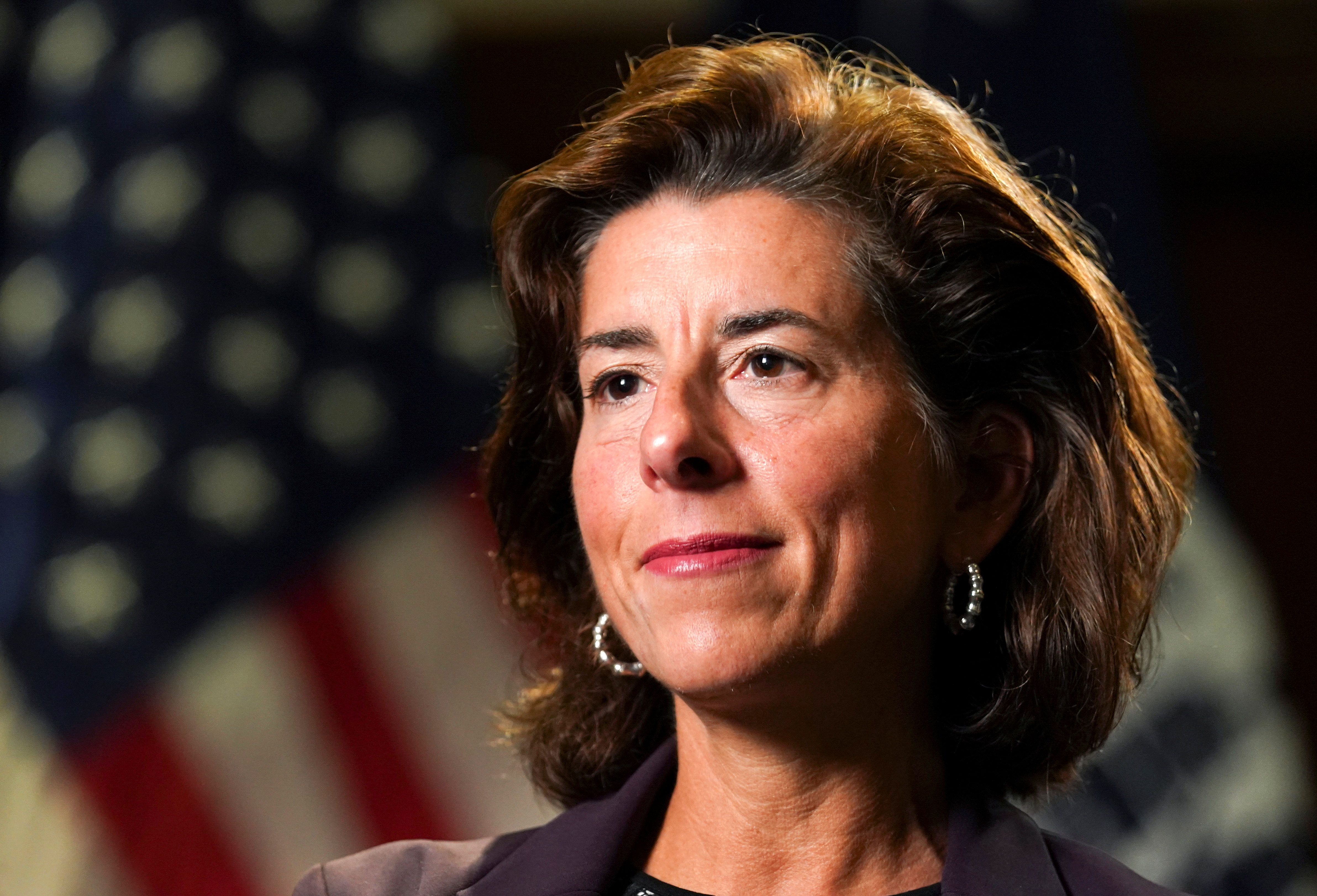 U.S. Commerce Secretary Gina Raimondo listens to a question during an interview with Reuters at the Department of Commerce in Washington U.S., September 23, 2021. REUTERS/Kevin Lamarque