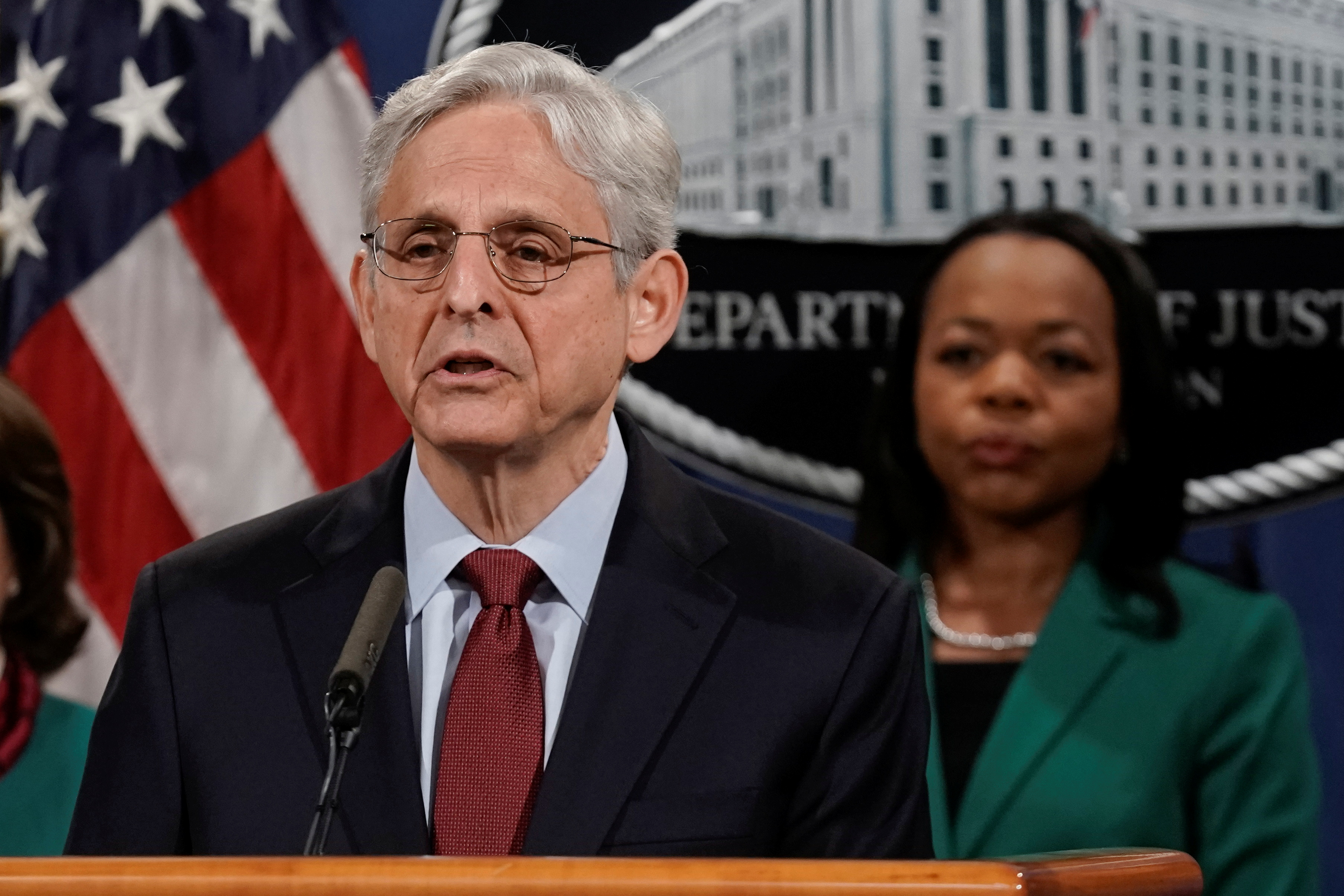 U.S. Attorney General Merrick Garland speaks accompanied by Assistant Attorney General for Civil Rights Kristen Clarke during a news conference to announce