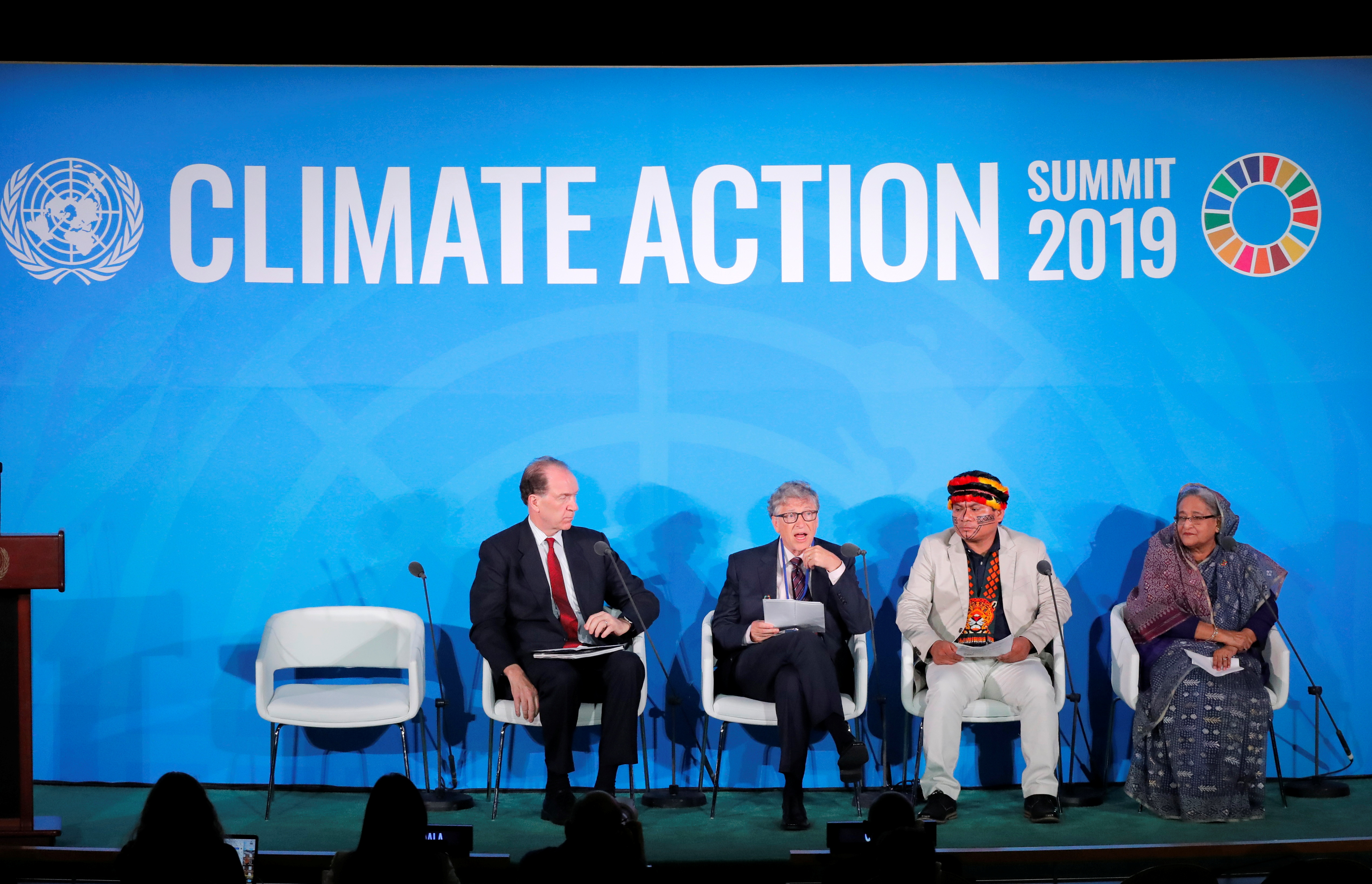 Bill Gates, Trustee and Co-Chair of the Global Commission on Adaptation, speaks as World Bank Group President David R. Malpass (L), Amazon-based indigenous leader Tuntiak Katan and Bangladesh's Prime Minister Sheikh Hasina (R) look on during the 2019 United Nations Climate Action Summit at U.N. headquarters in New York City, New York, U.S., September 23, 2019. REUTERS/Lucas Jackson/File Photo