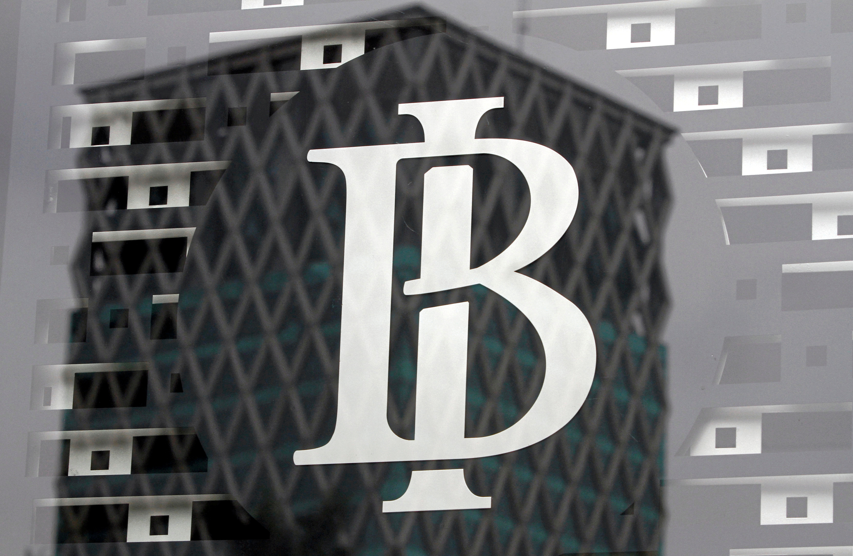 FILE PHOTO: The logo of Indonesia's central bank, Bank Indonesia, is seen on a window in the bank's lobby in Jakarta, Indonesia September 22, 2016. REUTERS/Iqro Rinaldi/File Photo