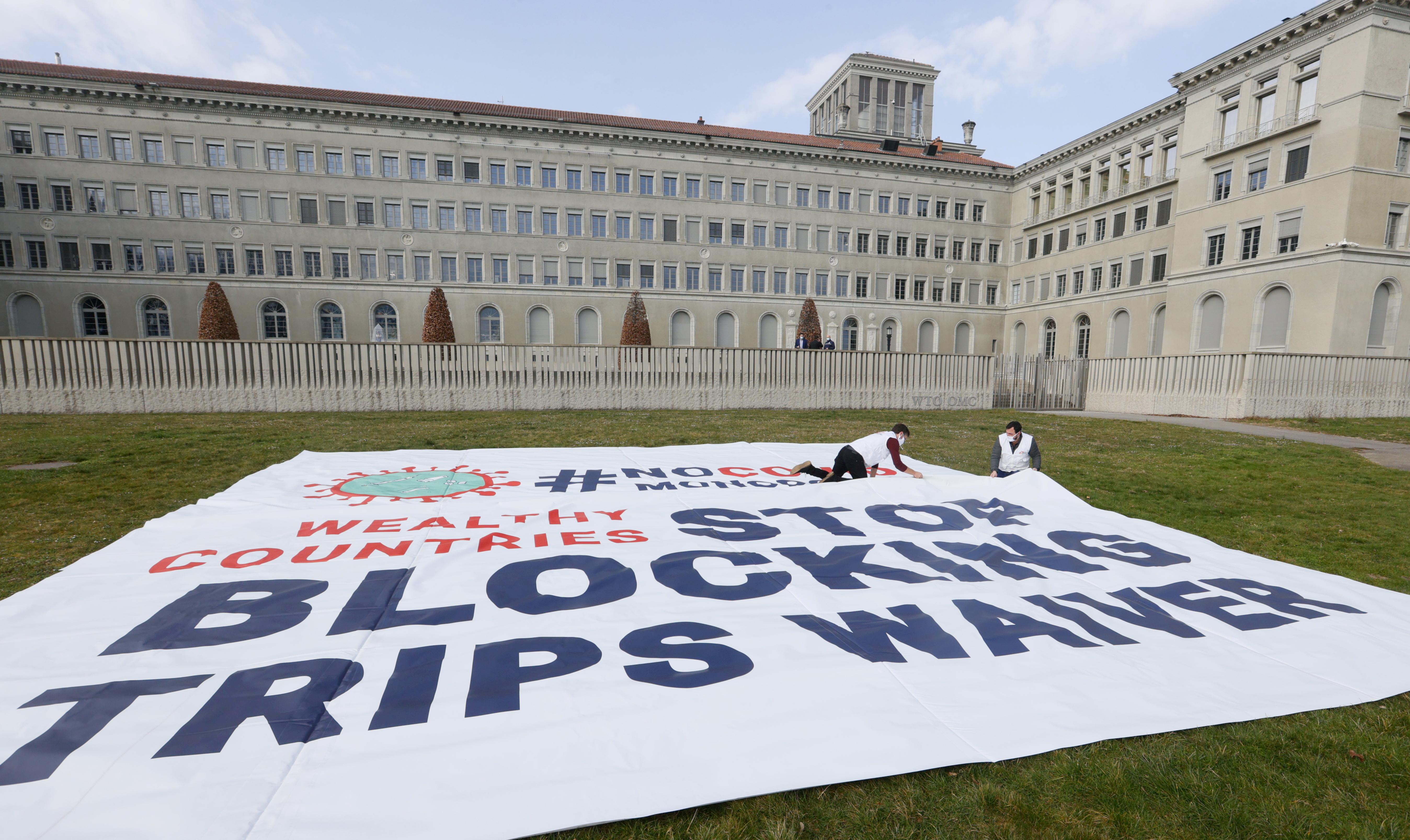 Members of aid group Doctors Without Borders (MSF) demonstrate outside the World Trade Organization to waive intellectual property rights on coronavirus disease (COVID-19) drugs ahead of next week meeting on WTO's Trade-Related Aspects of Intellectual Property (TRIPS) agreement in Geneva, Switzerland March 4, 2021.  REUTERS/Denis Balibouse