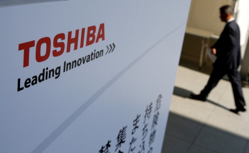 The logo of Toshiba is seen as a shareholder arrives at an extraordinary shareholders meeting in Chiba, Japan, March 30, 2017. REUTERS/Toru Hanai