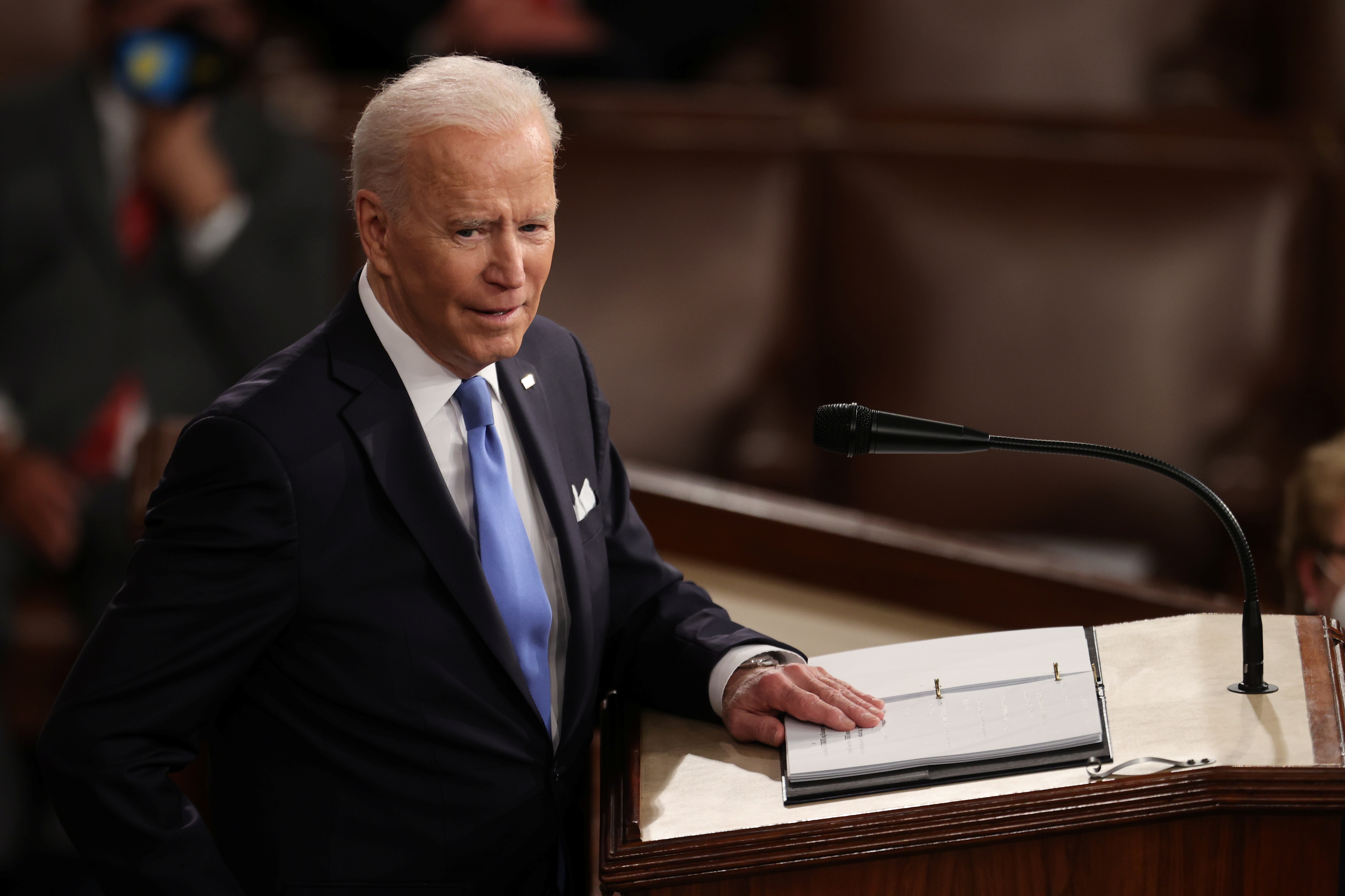 U.S. President Joe Biden delivers his first address to a socially distant joint session of the U.S. Congress inside the House Chamber of the U.S. Capitol in Washington, U.S., April 28, 2021. REUTERS/Jonathan Ernst/Pool