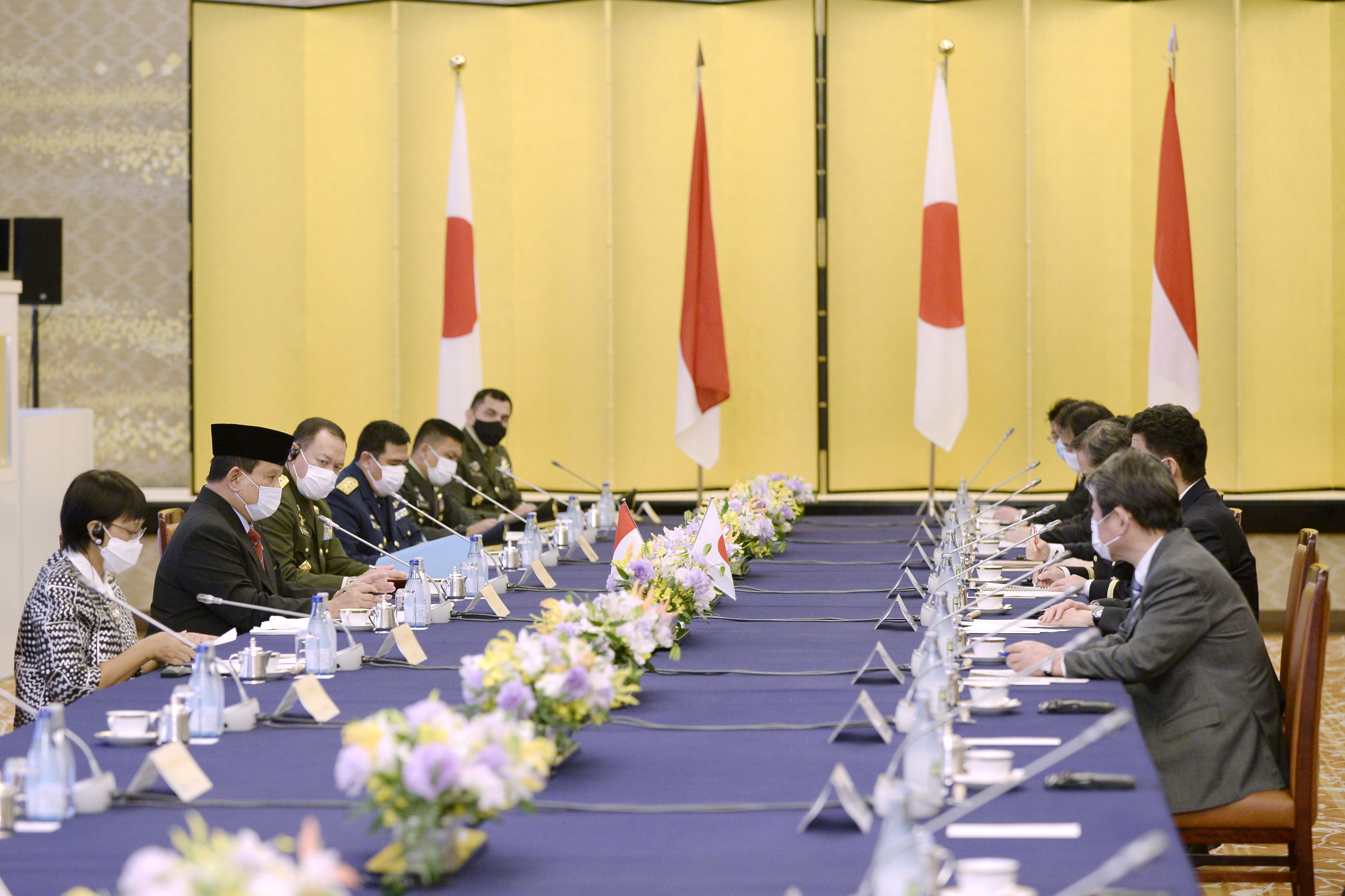Indonesian Foreign Minister Retno Marsudi and Defense Minister Prabowo Subianto speak with Japanese Foreign Minister Toshimitsu Motegi and Defense Minister Kishi Nobuo during the