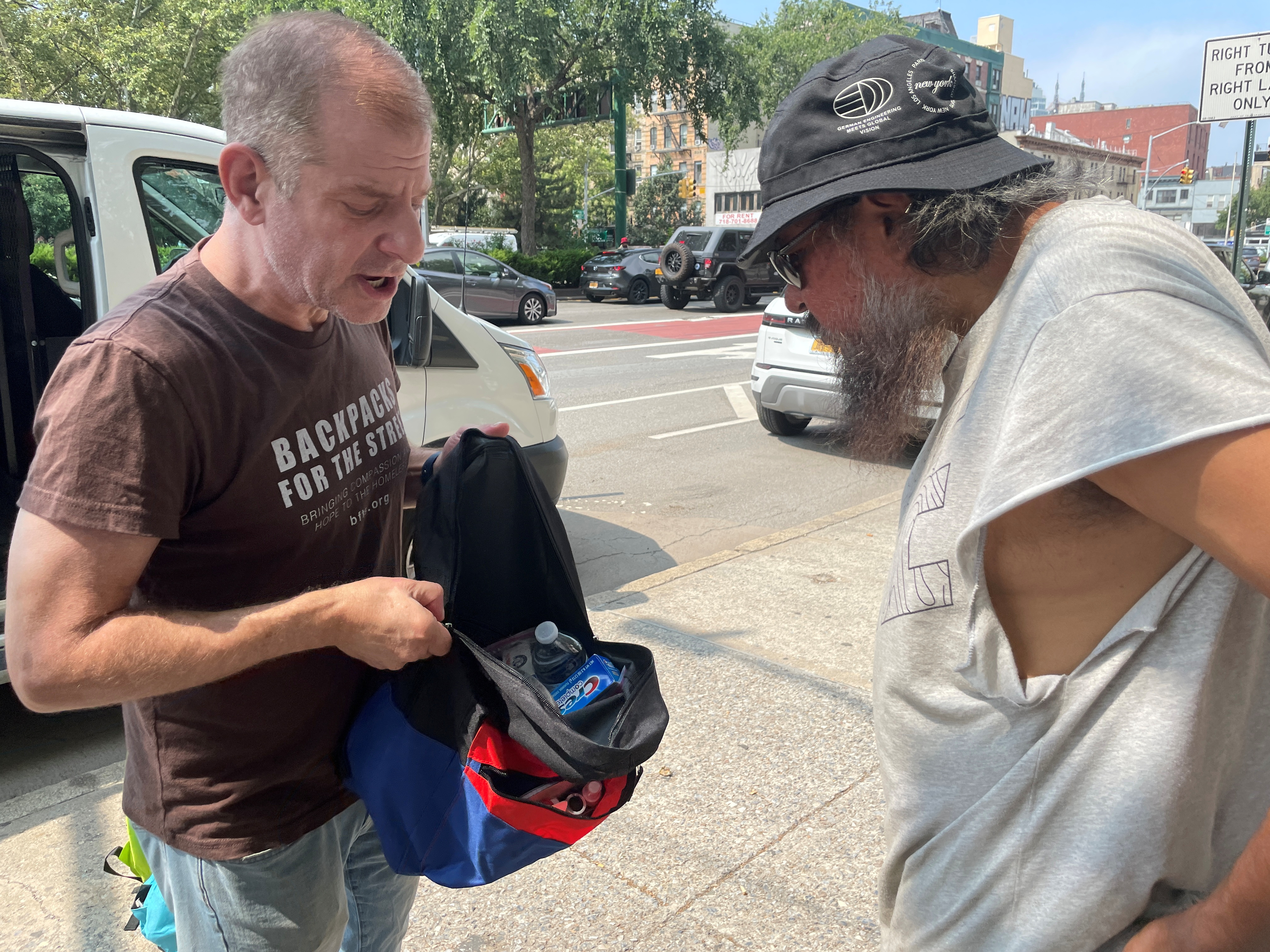 Backpacks For The Street's President and CEO Jeffrey Newman shows a backpack with supplies for the homeless, in New York City, U.S., August 10, 2021. REUTERS/Roselle Chen