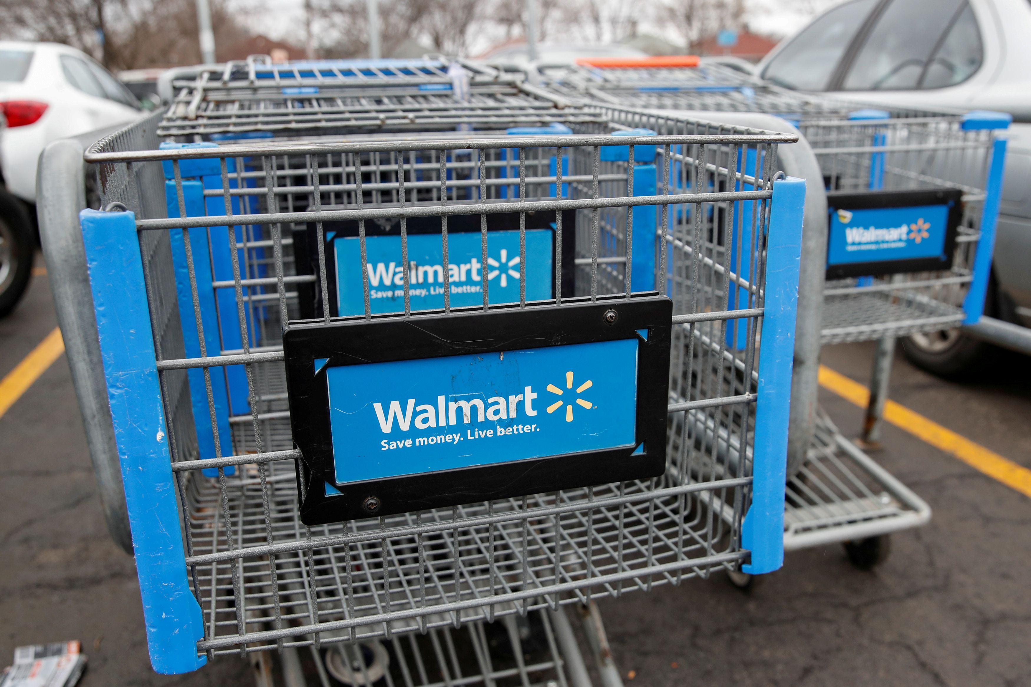 Walmart shopping carts are seen on the parking lot ahead of the Thanksgiving holiday in Chicago, Illinois, U.S. November 27, 2019. REUTERS/Kamil Krzaczynski/File Photo