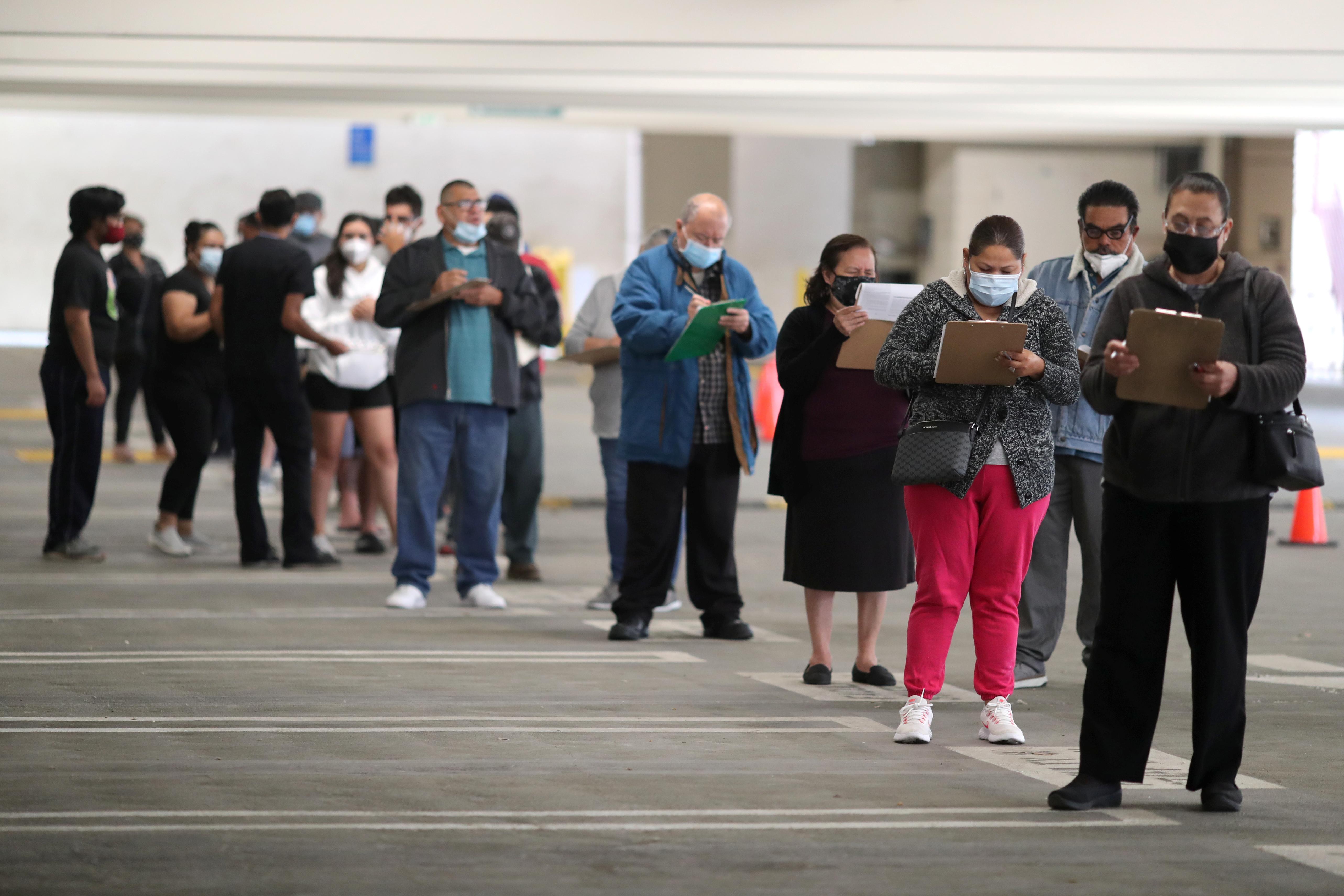 People wait for coronavirus disease (COVID-19) vaccinations, in Los Angeles, California, U.S., April 12, 2021. REUTERS/Lucy Nicholson
