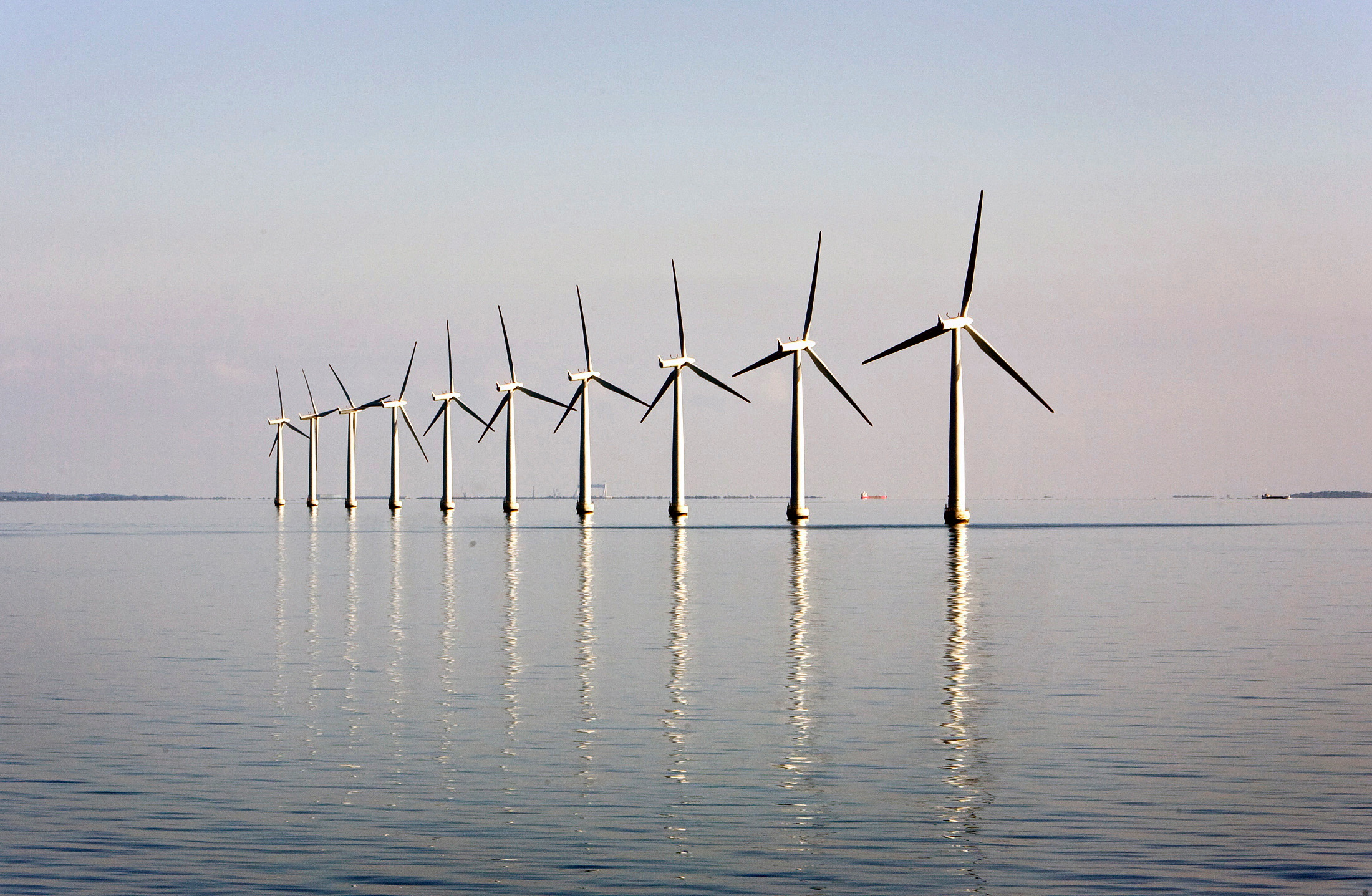 An offshore wind farm stands in the water near the windswept Danish island of Samso May 19, 2008. REUTERS/Bob Strong