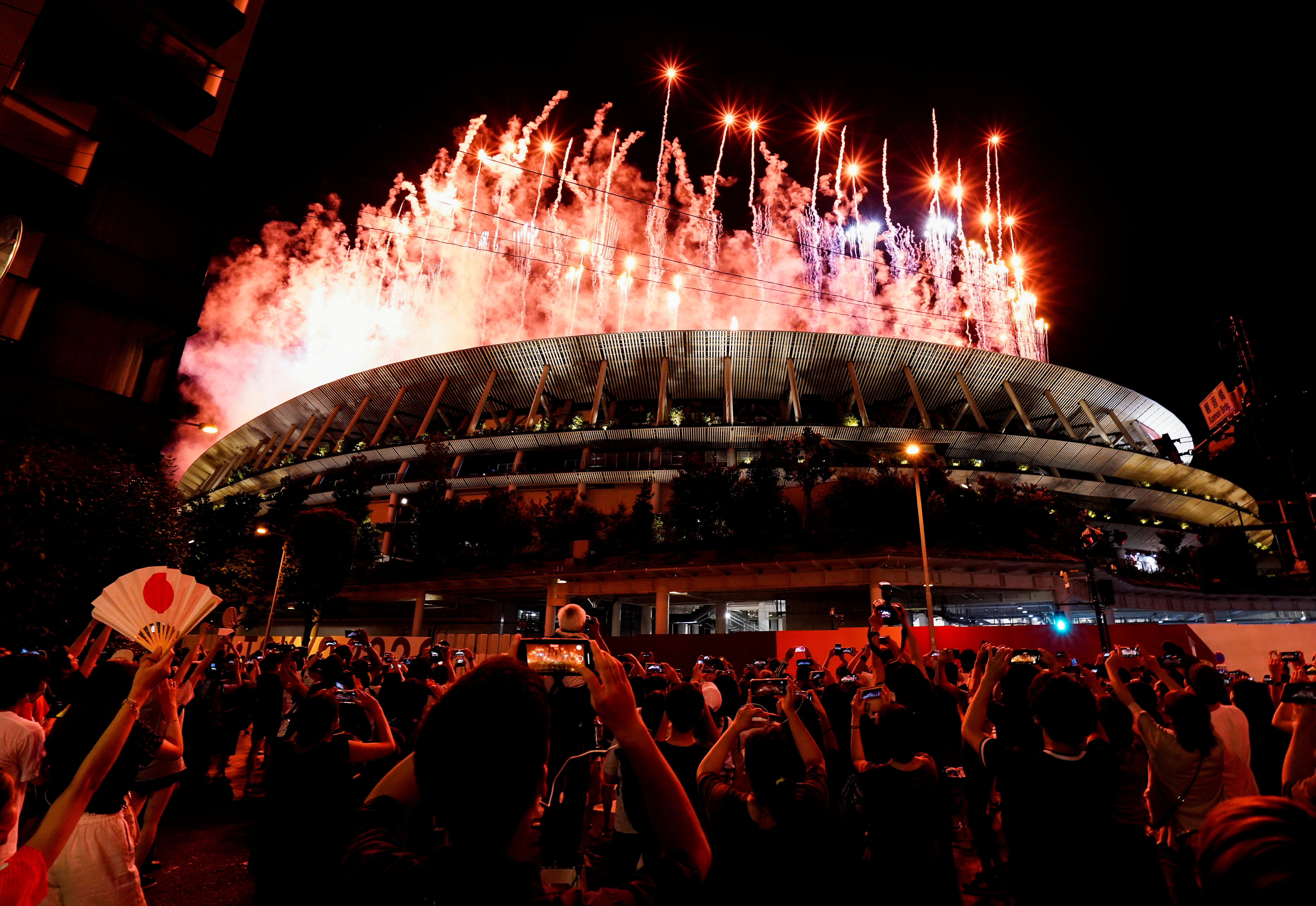 Tokyo 2020 Olympics - The Tokyo 2020 Olympics Opening Ceremony - Olympic Stadium, Tokyo, Japan - July 23, 2021. Fireworks are seen from outside the stadium during the Opening Ceremony. REUTERS/Naoki Ogura